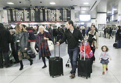 Travelers walk through New York's Penn Station, Wednesd. Around 43.6 million Americans were expected to journey 50 miles or more between Wednesday and Sunday, just a 0.7 percent increase from last year, according to AAA's yearly Thanksgiving travel analysis.