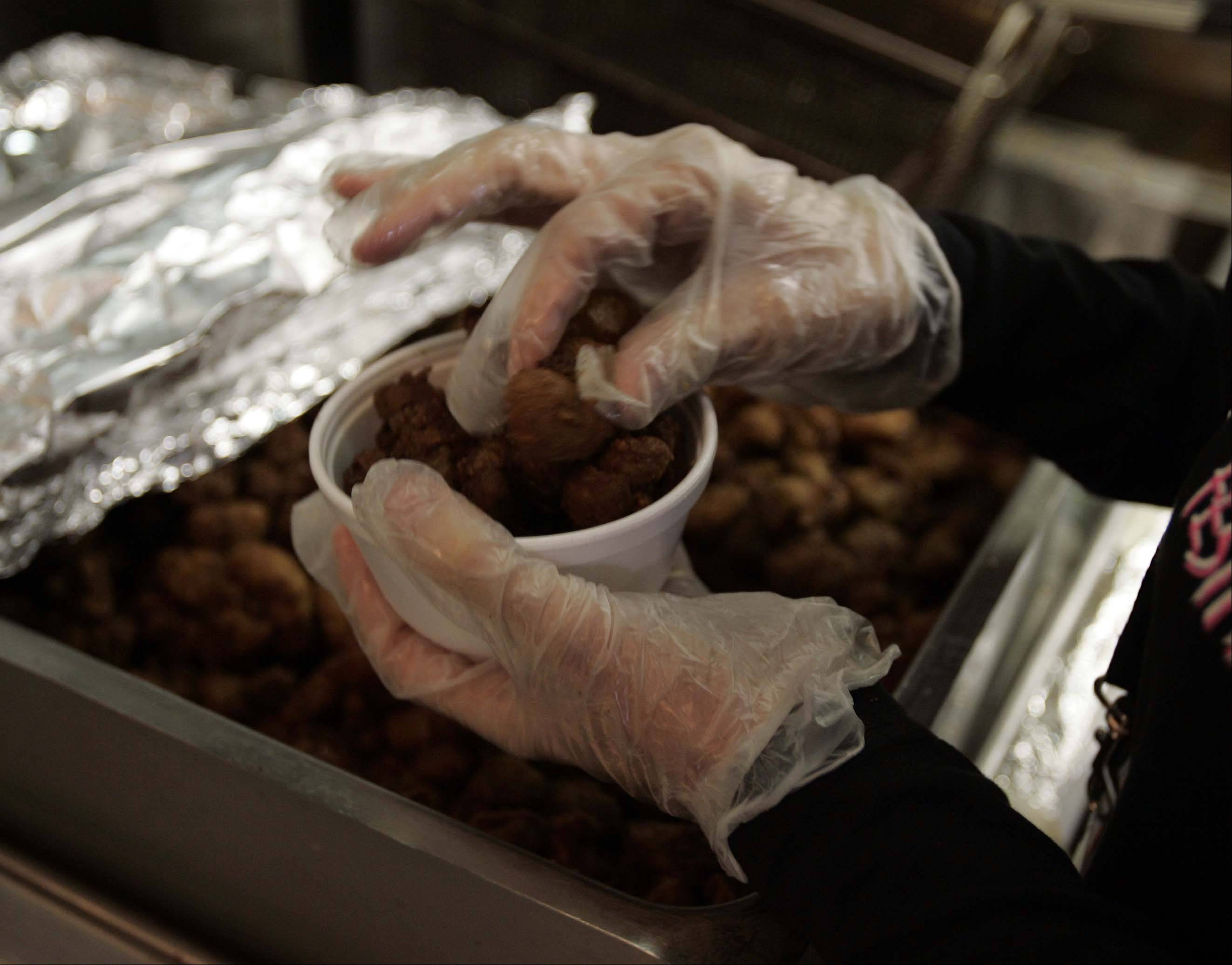 A Parkside Pub employee prepares a bowl of freshly fried turkey testicles.