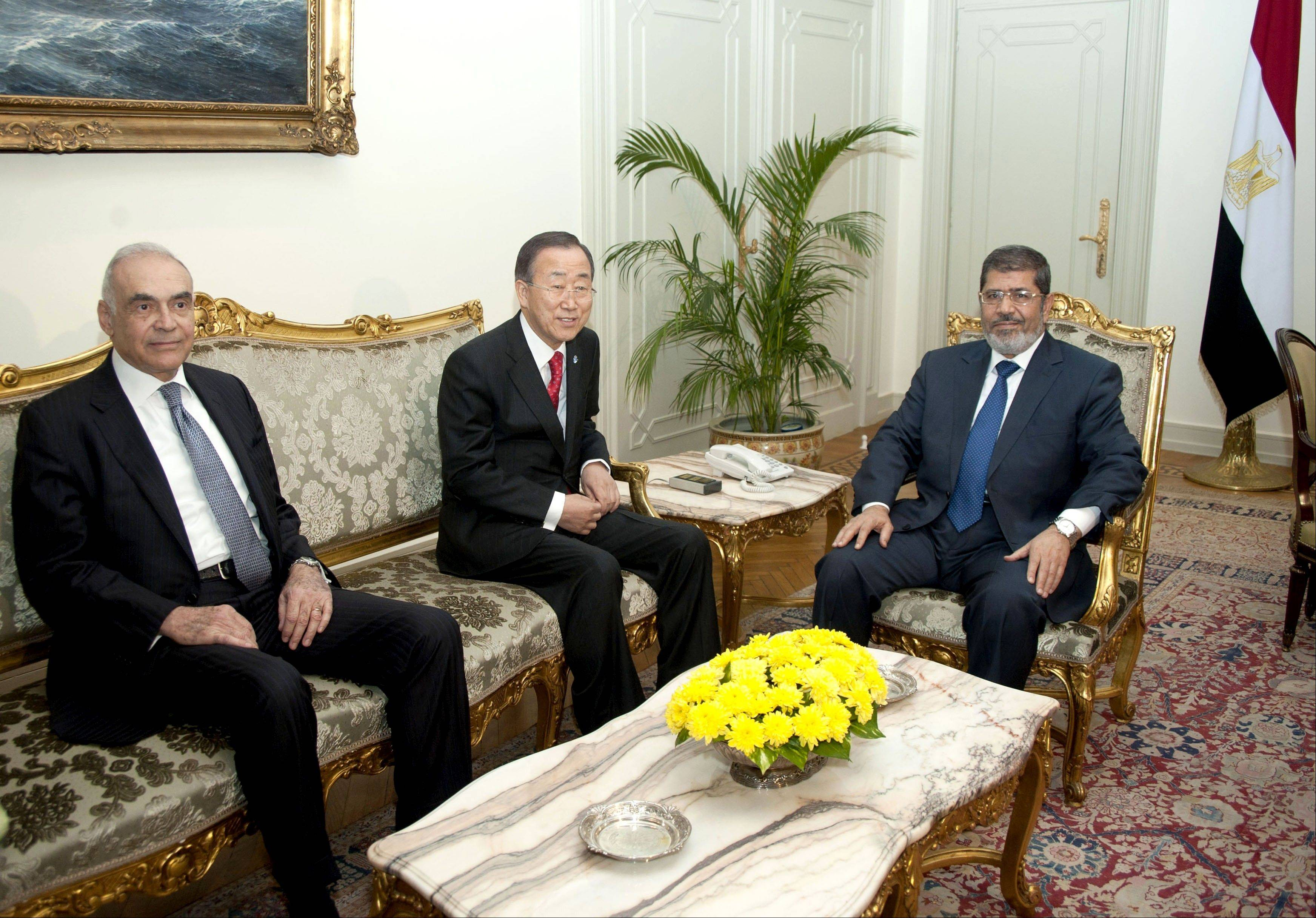 U.N. Secretary-General Ban Ki-moon, center, poses for photographers during his meeting with Egyptian Foreign Minister Mohammed Kamel Amr, left, and President Mohammed Morsi, right, in Cairo, Egypt, Wednesday.