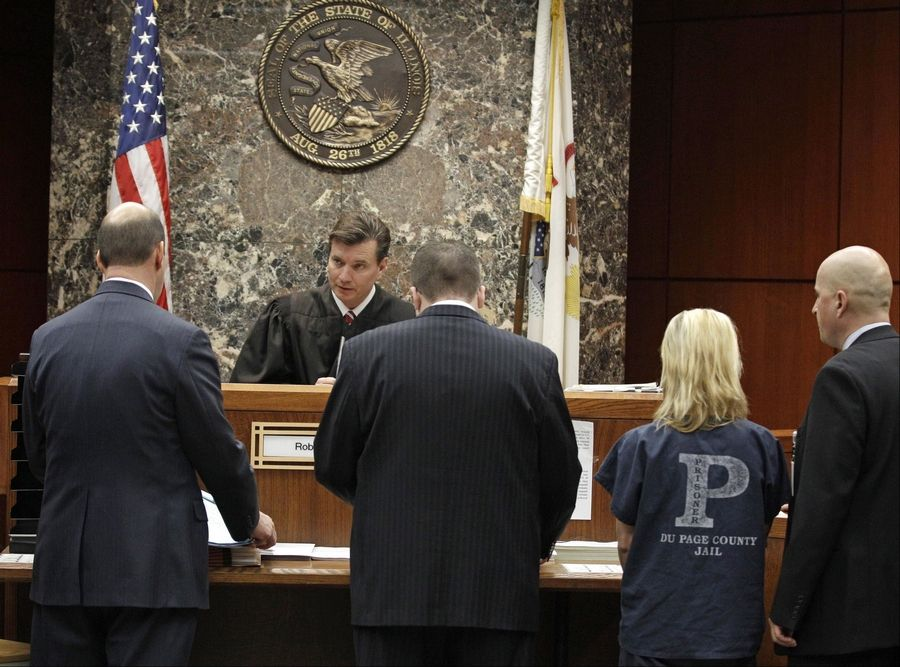 From left, DuPage State's Attorney Bob Berlin, Senior Assistant Public Defender Mike Mara, Elzbieta Plackowska and interpreter Adam Kleczyngier appear in the courtroom of DuPage County Judge Robert Kleeman.