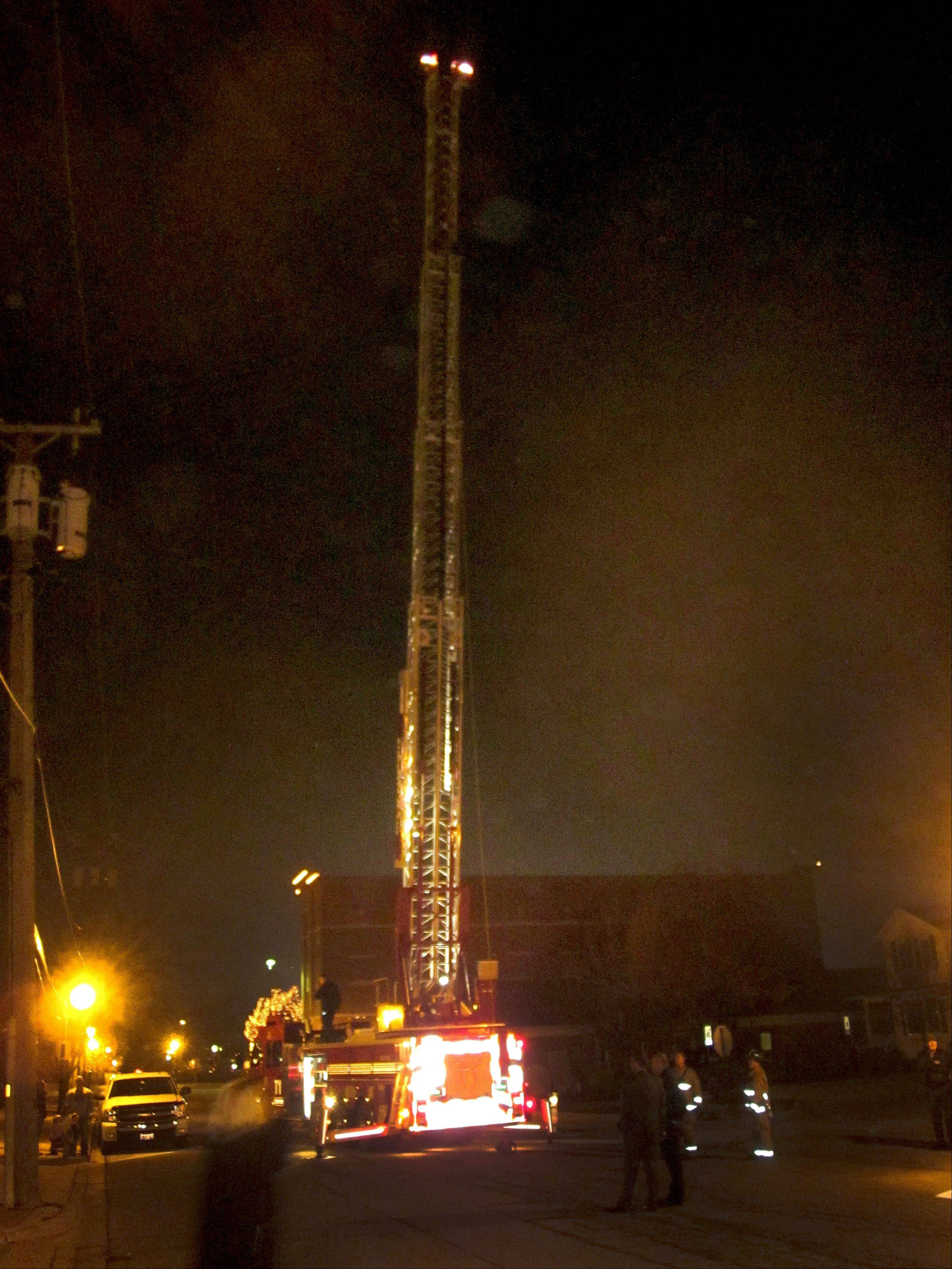A Naperville fire truck was brought to Water Street Tuesday night to help residents and city officials estimate the height of the proposed Water Street development. Fully extended, the lights atop the ladder represent the proposed height of nearly 88-feet.
