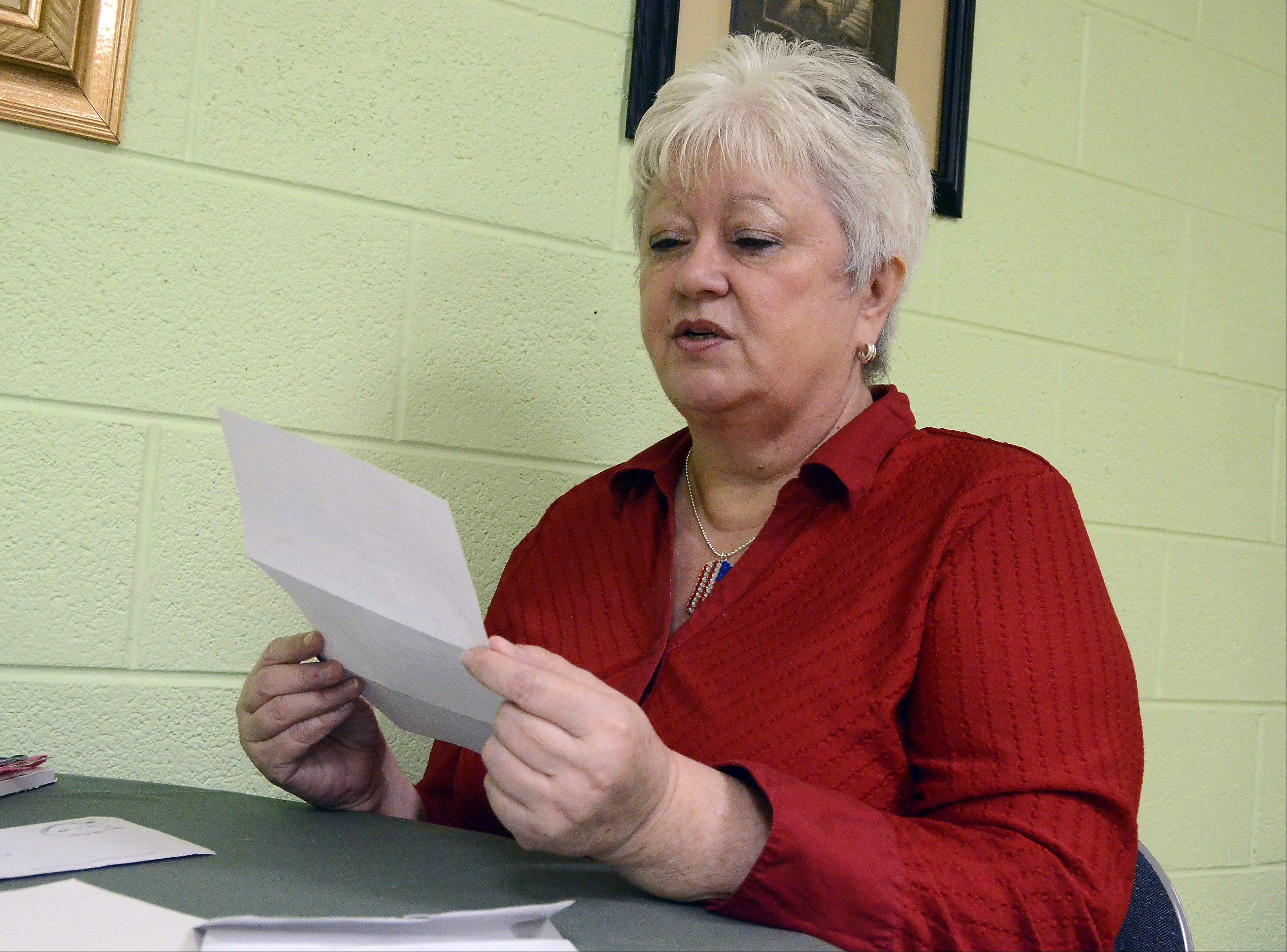 Cheryl Talaczynski of Arlington Heights reads a response from Sgt. Lorenzo in Afghanistan, who was sent one of her handmade greeting cards last year.