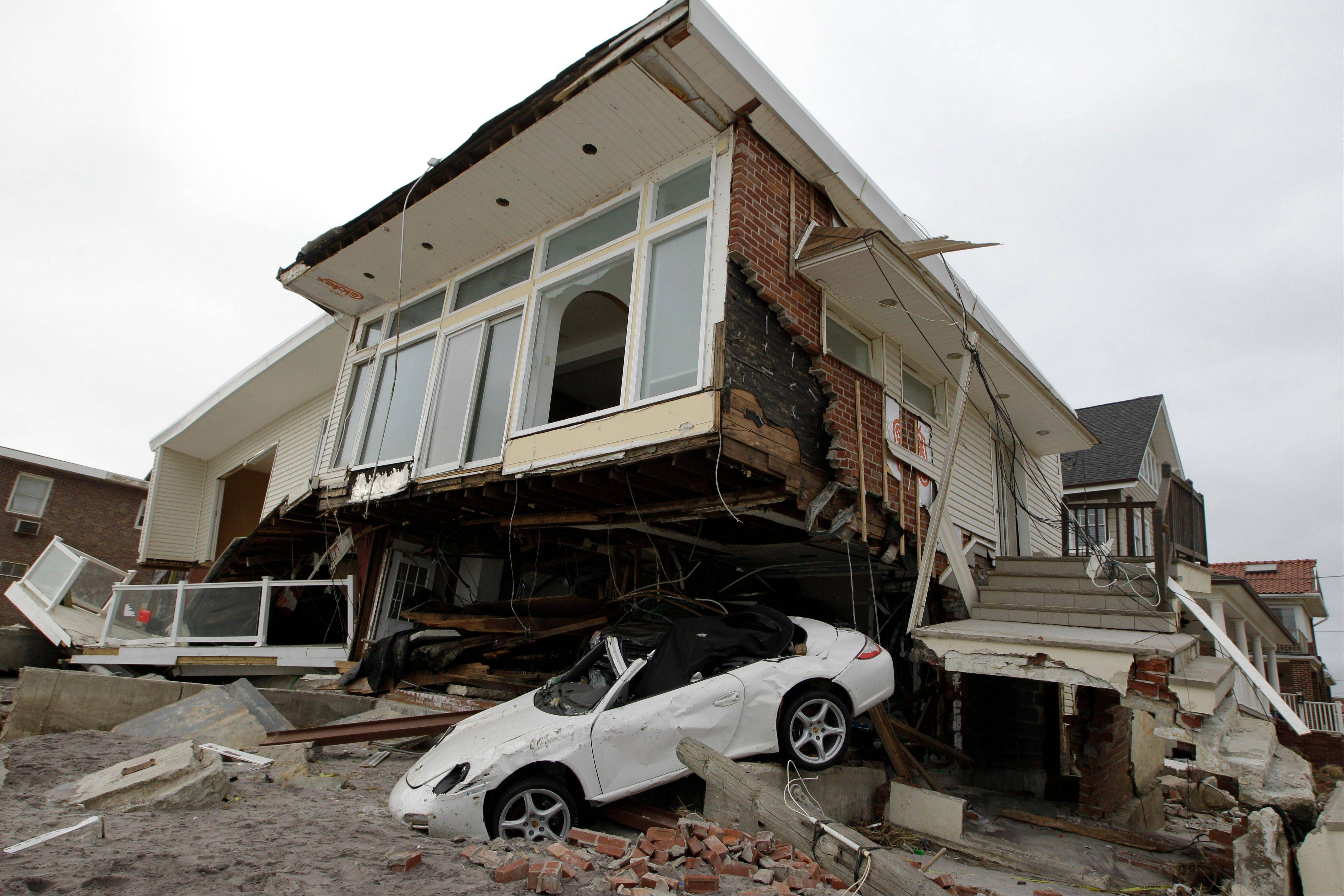 A beach side house, deemed uninhabitable by the New York City Department of Buildings, sits in ruins Monday in the Belle Harbor neighborhood of the Rockaways.