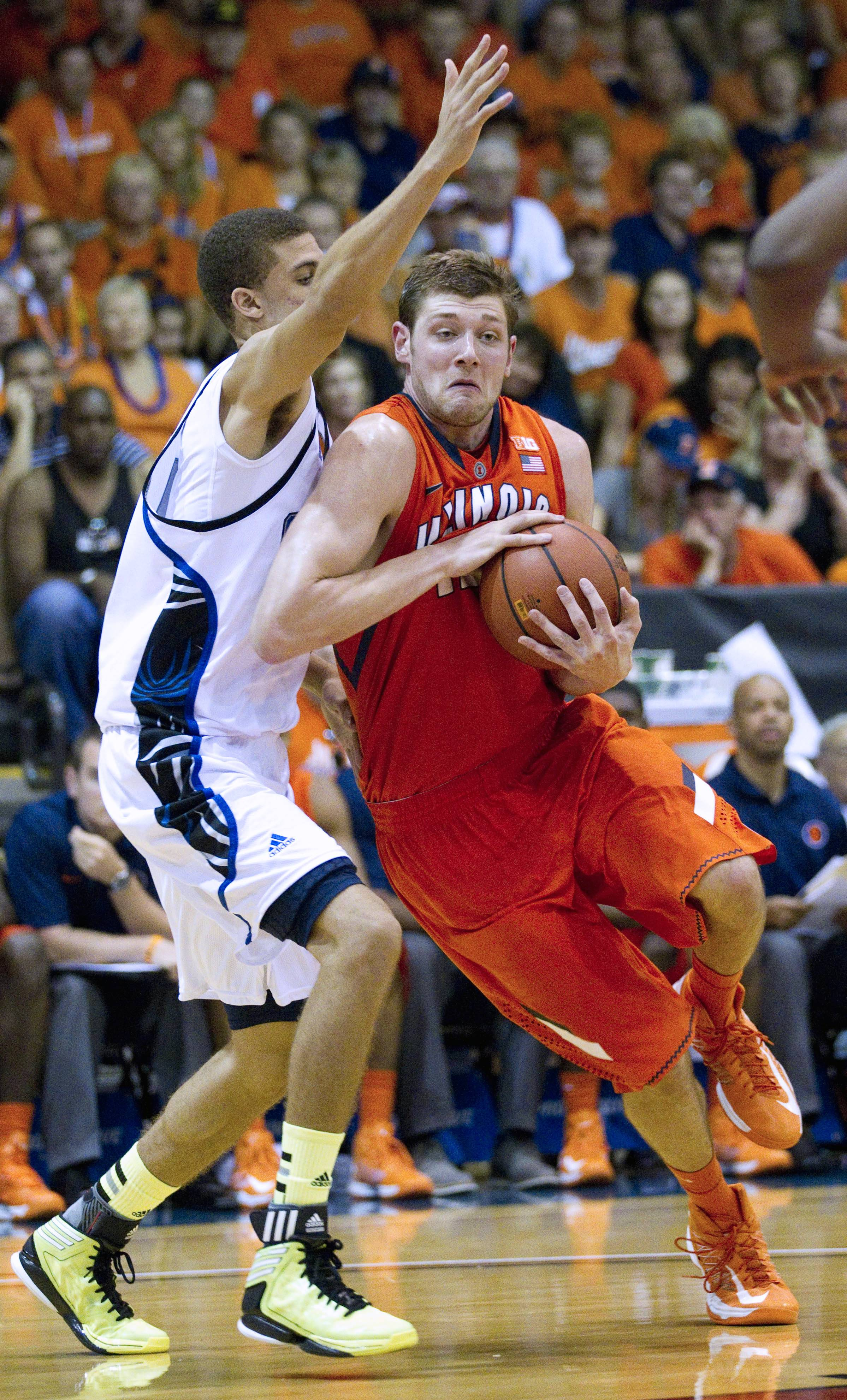 Chaminade forward Tyree Harrison, left, defends Illinois forward Tyler Griffey, right, Tuesday during the second half at the Maui Invitational in Lahaina, Hawaii. Illinois defeated Chaminade 84-61.