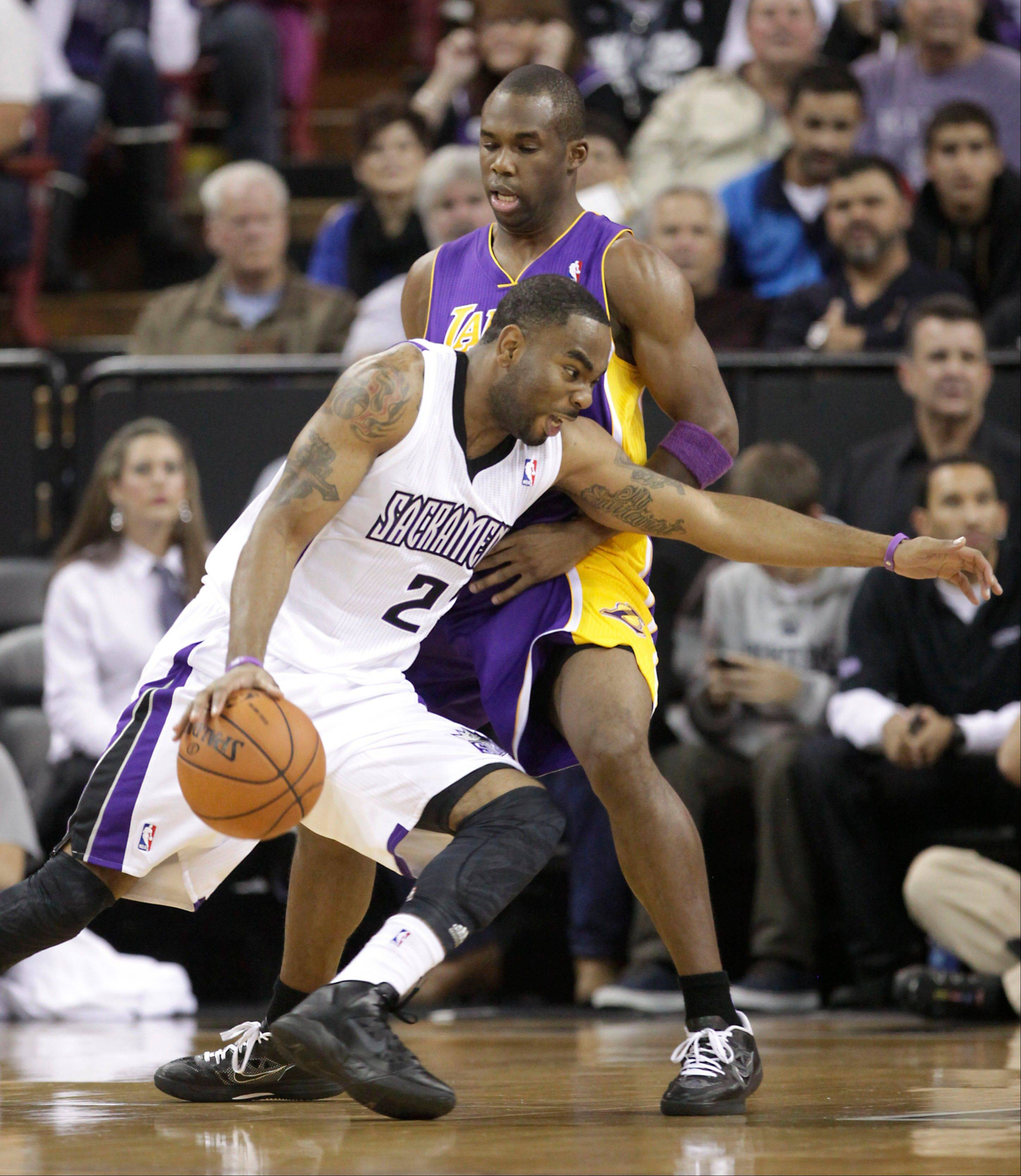 Kings guard Marcus Thornton drives against Los Angeles guard Jodie Meeks during the first quarter Wednesday in Sacramento, Calif.