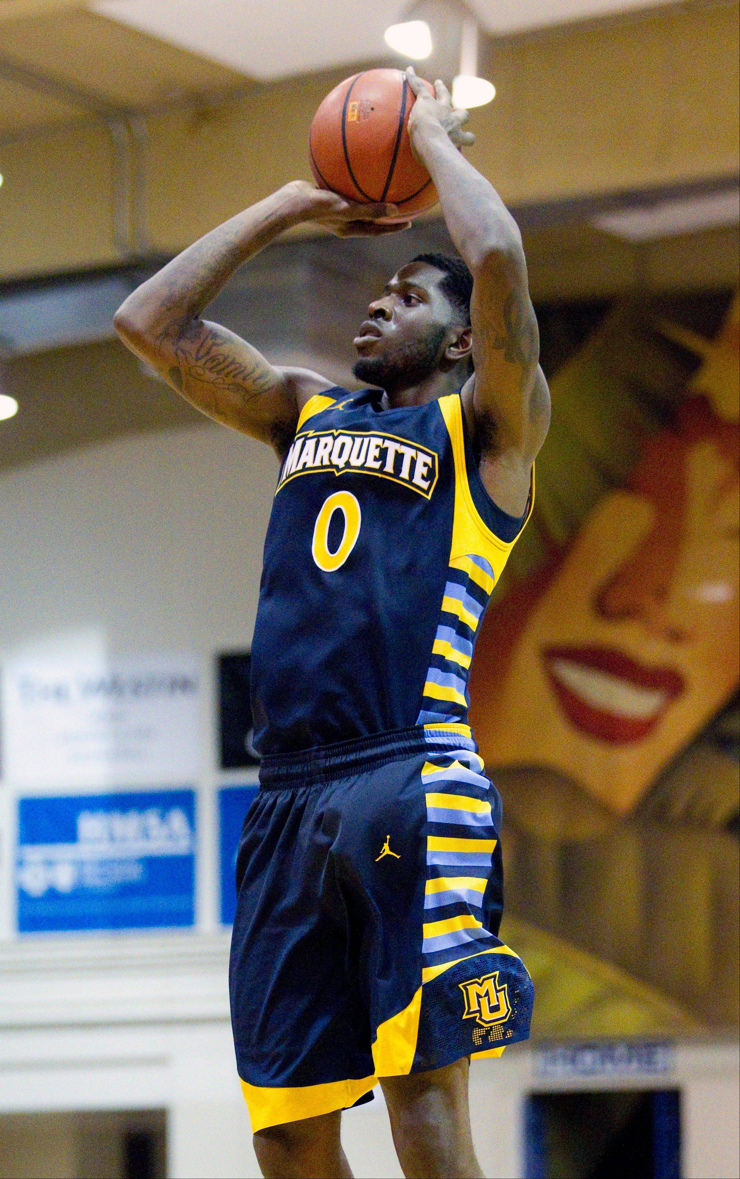 Marquette forward Jamil Wilson takes a jump shot in the second half while playing against Southern California Wednesday in the Maui Invitational.