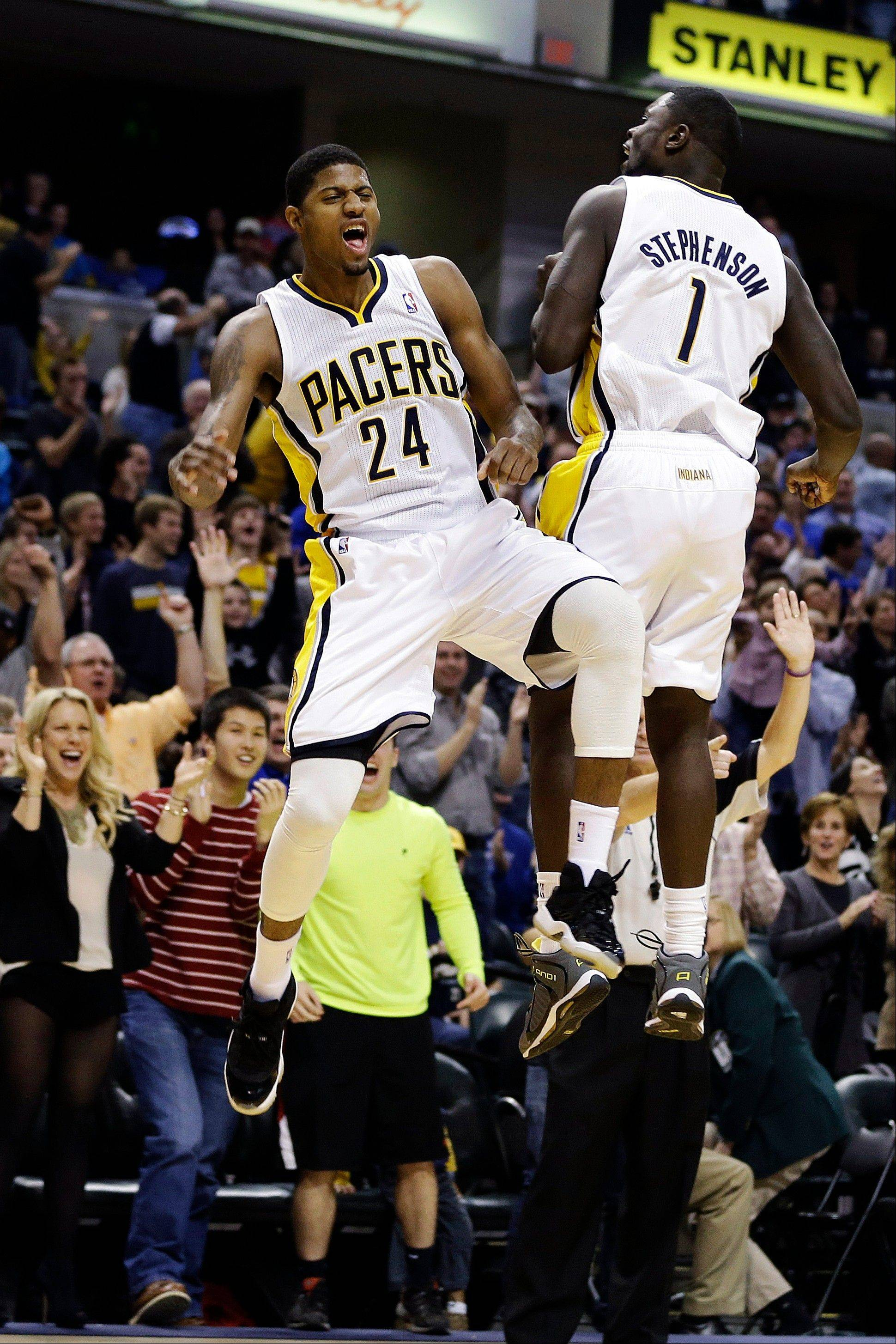 The Pacers' Paul George (24) and Lance Stephenson celebrate after George hit a 3-pointer during the second half Wednesday at home against New Orleans.
