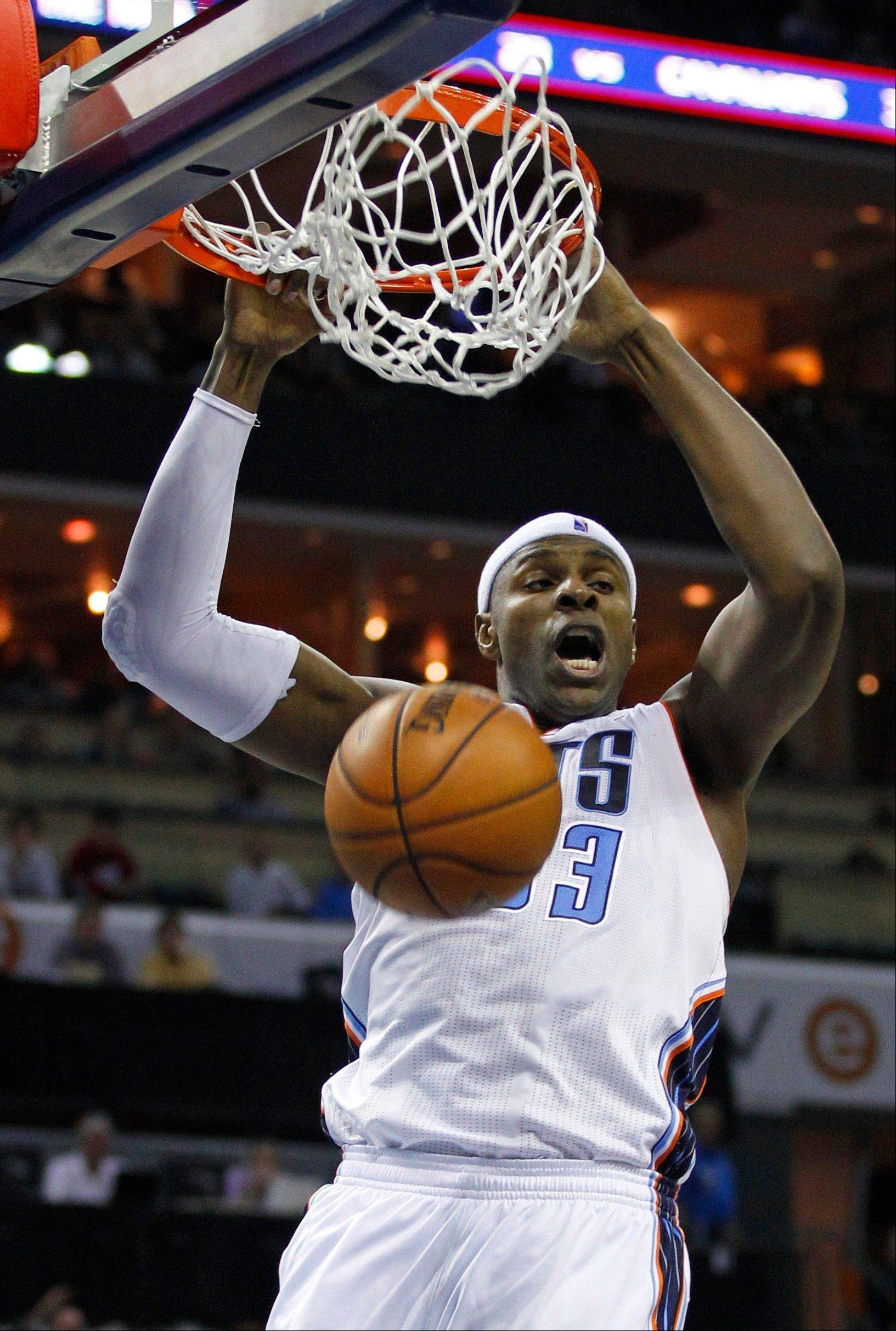 The Bobcats' Brendan Haywood dunks against the Toronto Raptors during the first half Wednesday in Charlotte, N.C.