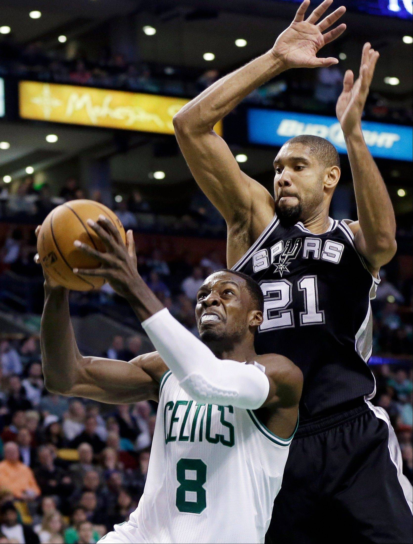 San Antonio Spurs power forward Tim Duncan (21) defends against Boston Celtics forward Jeff Green (8) during the second half Wednesday in Boston.