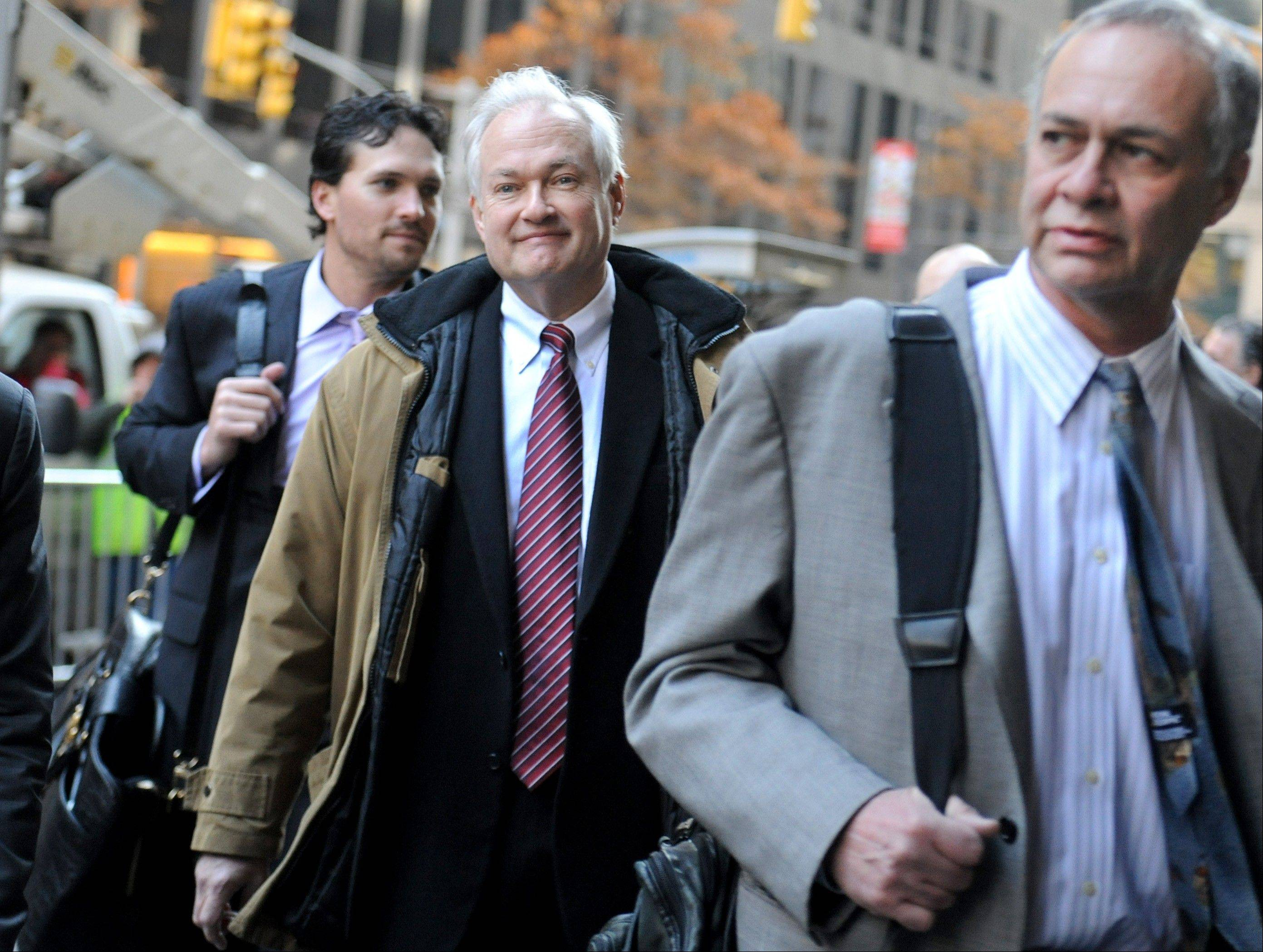 NHL Players' Association executive director Donald Fehr, center, arrives Wednesday for labor talks at NHL headquarters in New York with his brother, NHLPA counsel Steven Fehr.