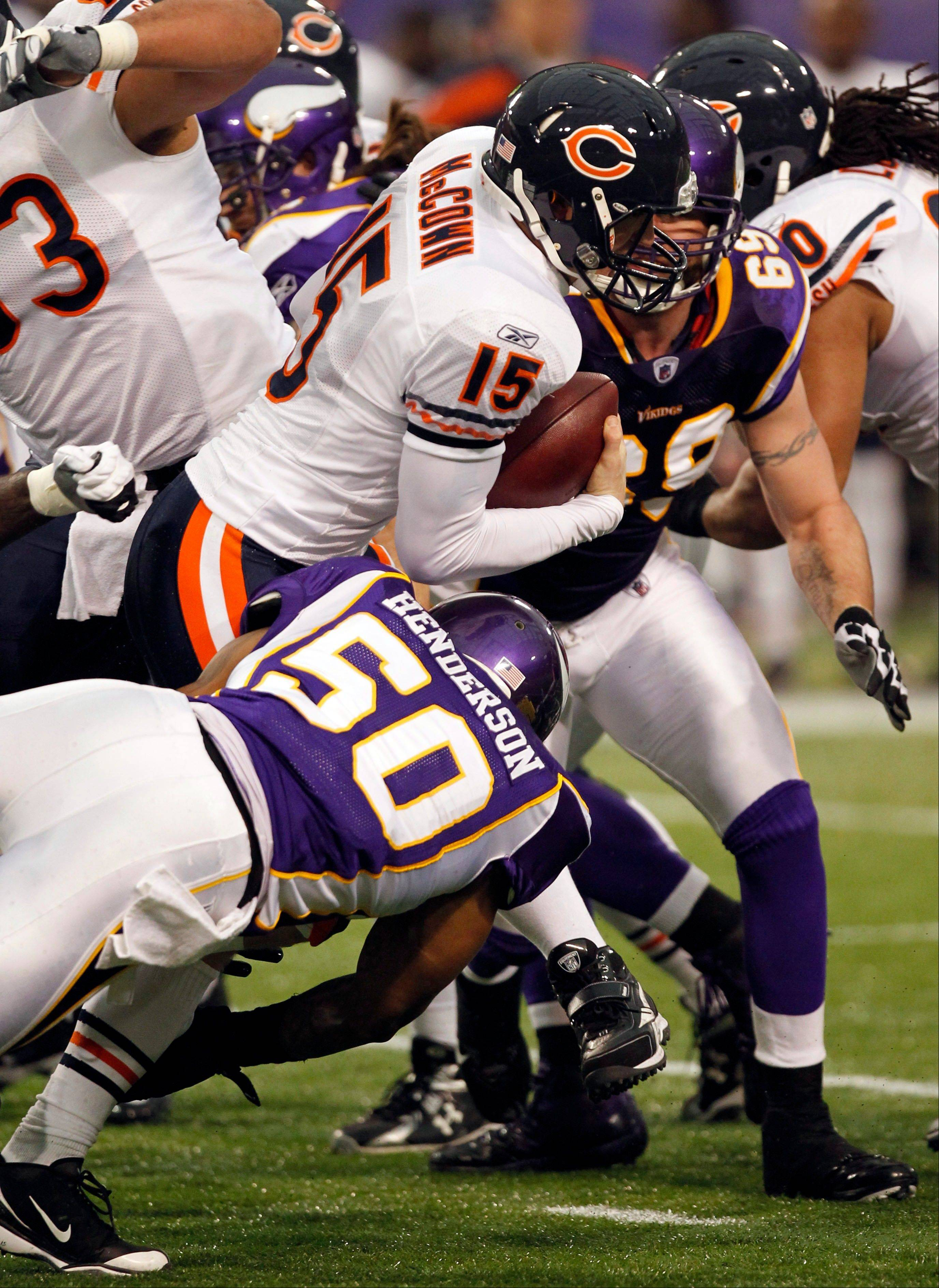 Bears quarterback Josh McCown gets sacked by Minnesota Vikings outside linebacker Erin Henderson (50) and defensive end Jared Allen (69) last season. After tying for the NFL lead with 50 sacks last year, the Vikings have slipped a bit. They're tied for 11th in the league with 26.