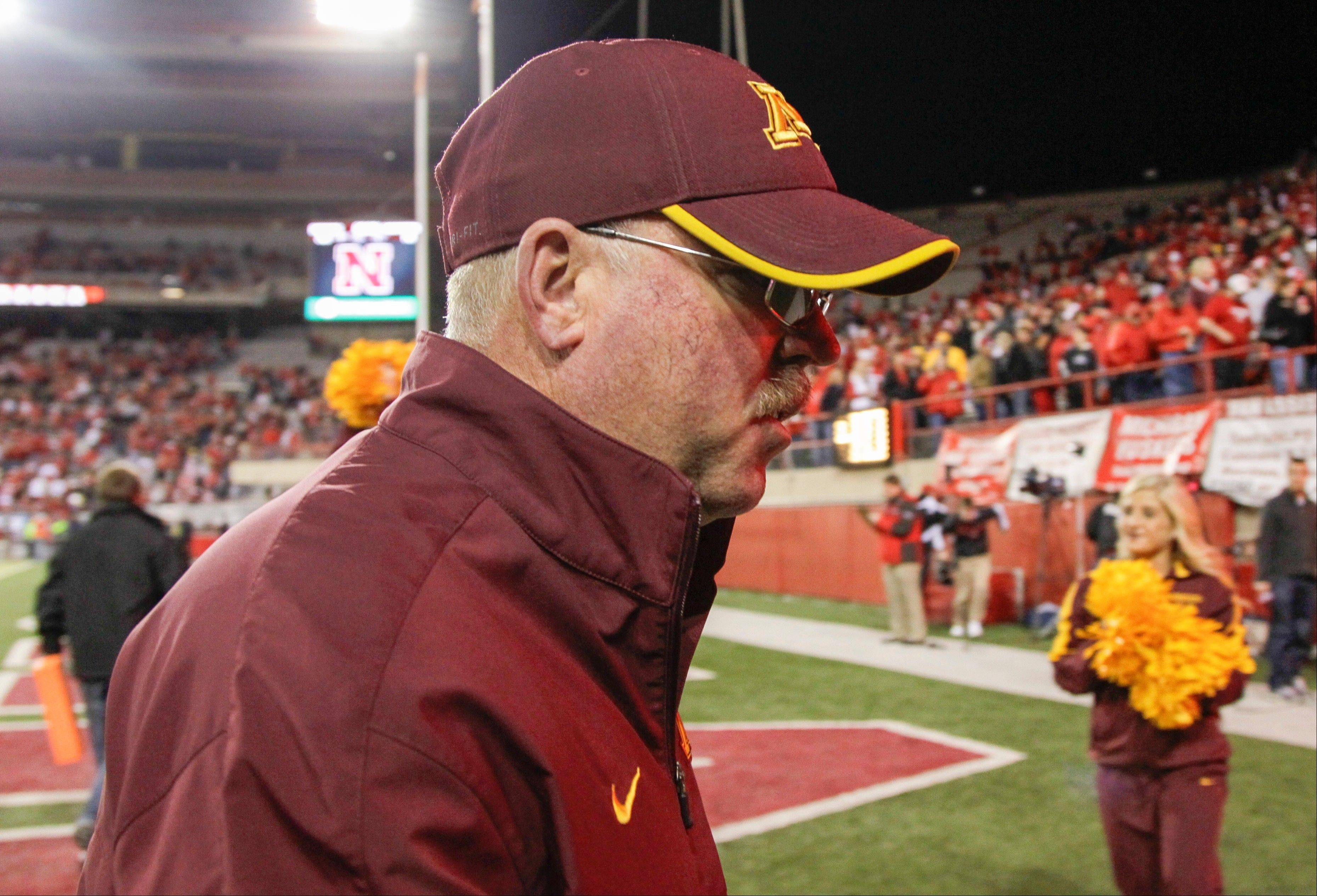 Minnesota head coach Jerry Kill walks off the field Satuday following a 38-14 loss to Nebraska, in Lincoln. The departure of leading receiver A.J. Barker, who angrily quit the team on Sunday by an email to coach Jerry Kill that he took public on his personal blog, was a surprise to the players he left behind.