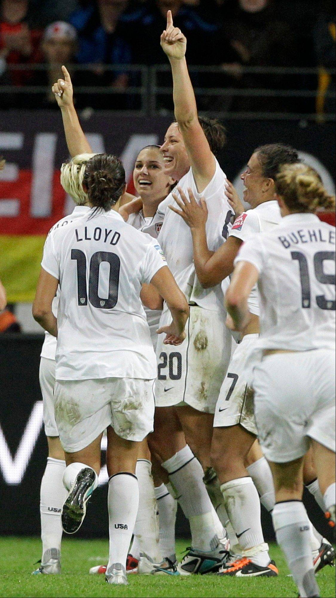United States World Cup stars such as Alex Morgan, center left, and Abby Wambach and other teammates will have a new option to consider with the third try at a professional league for women's soccer.