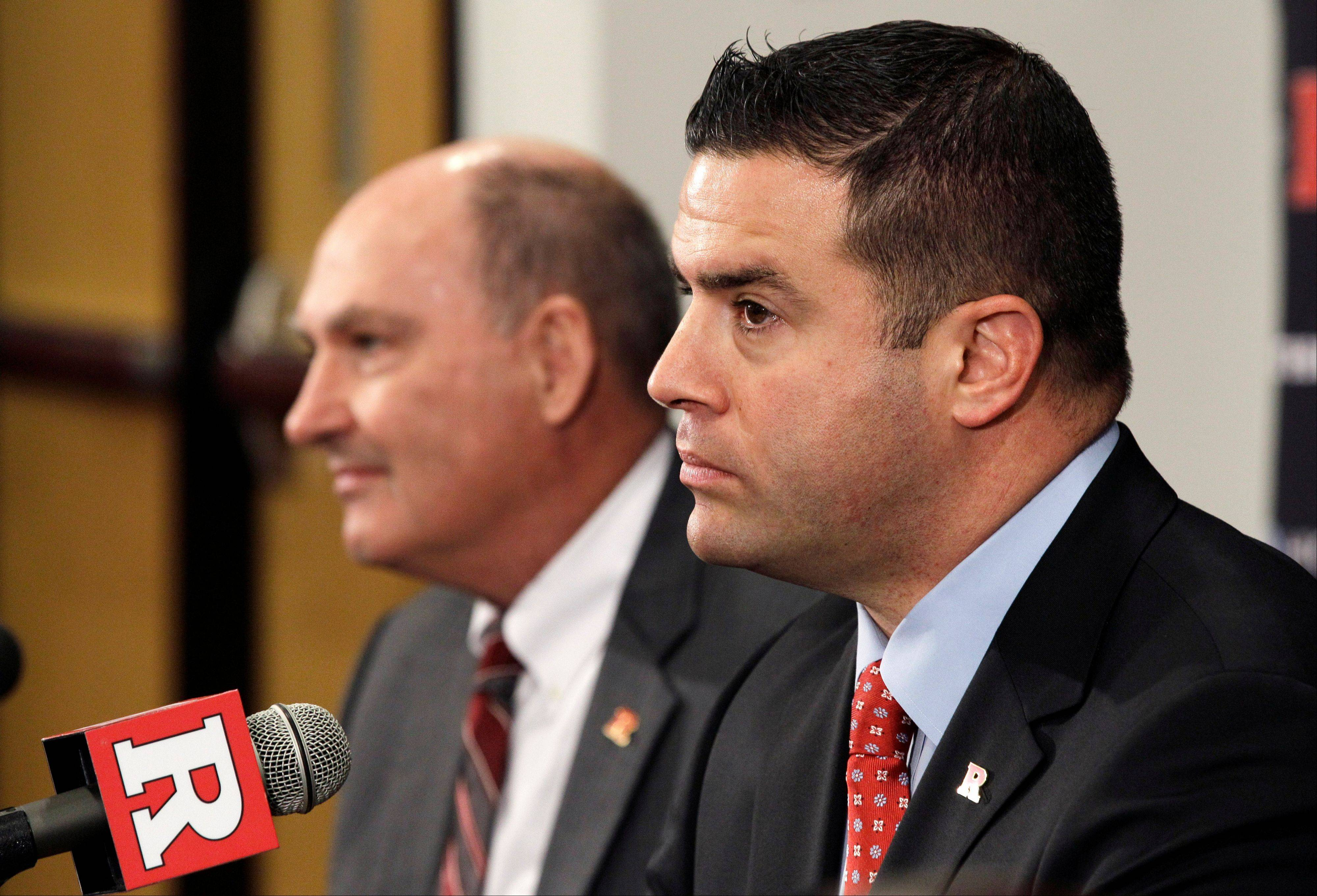 Rutgers director of athletics Tim Pernetti, right, and Big Ten commissioner Jim Delany listen to a question during a news conference Tuesday after they announced that Rutgers will join the Big Ten at a date to be determined.