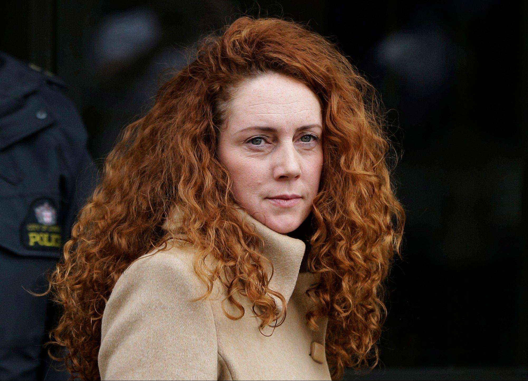 Rebekah Brooks, former chief of News Corp.�s British operations, leaves the Old Bailey court in London. Two former confidants of Britain�s prime minister, former tabloid editors Andy Coulson and Brooks, were charged Nov. 20 with conspiring to pay public officials in exchange for stories and information.