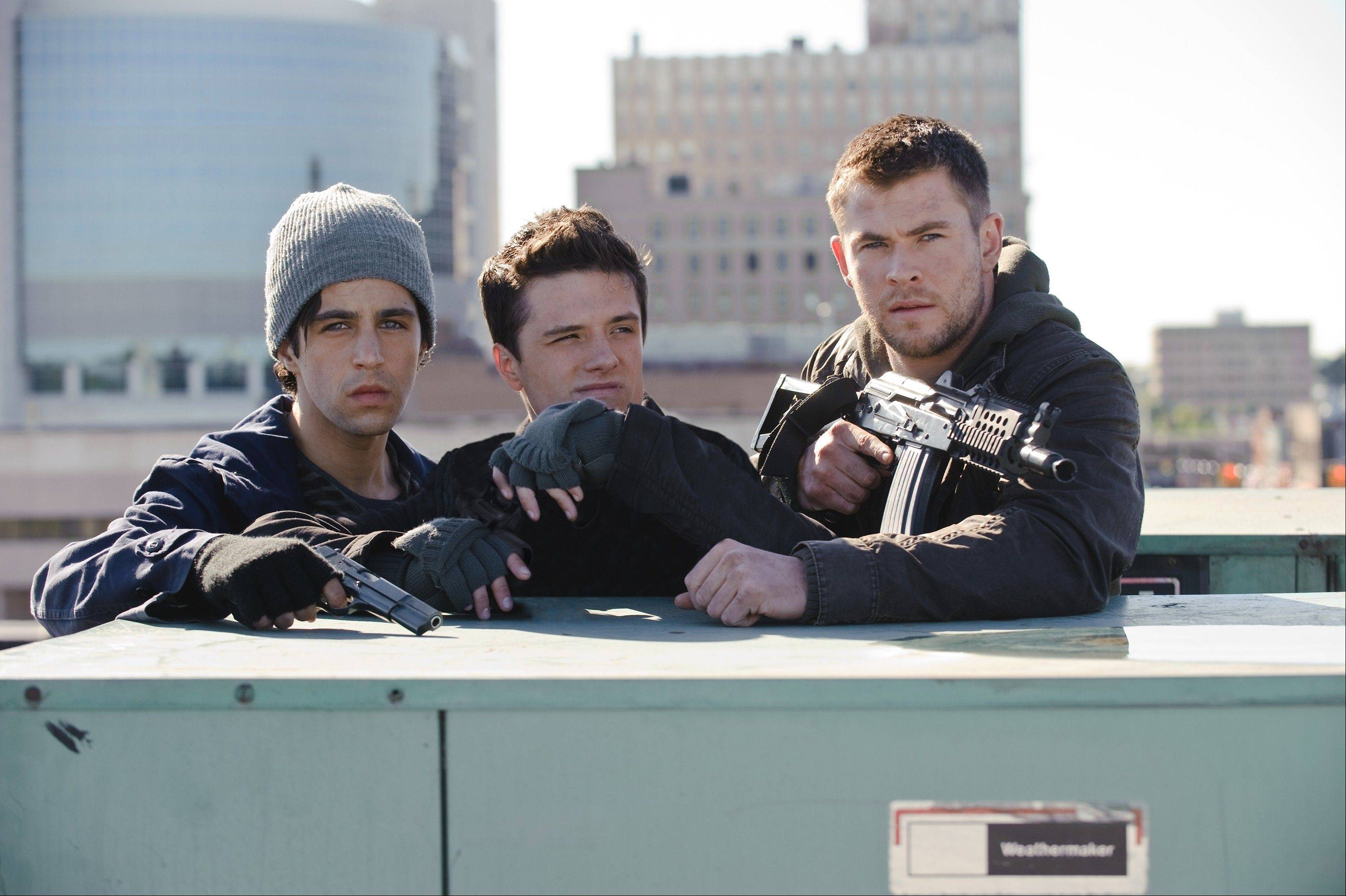 "Josh Peck, left, joins Josh Hutcherson and Chris Hemsworth as freedom fighters in the USA invasion thriller remake ""Red Dawn."""