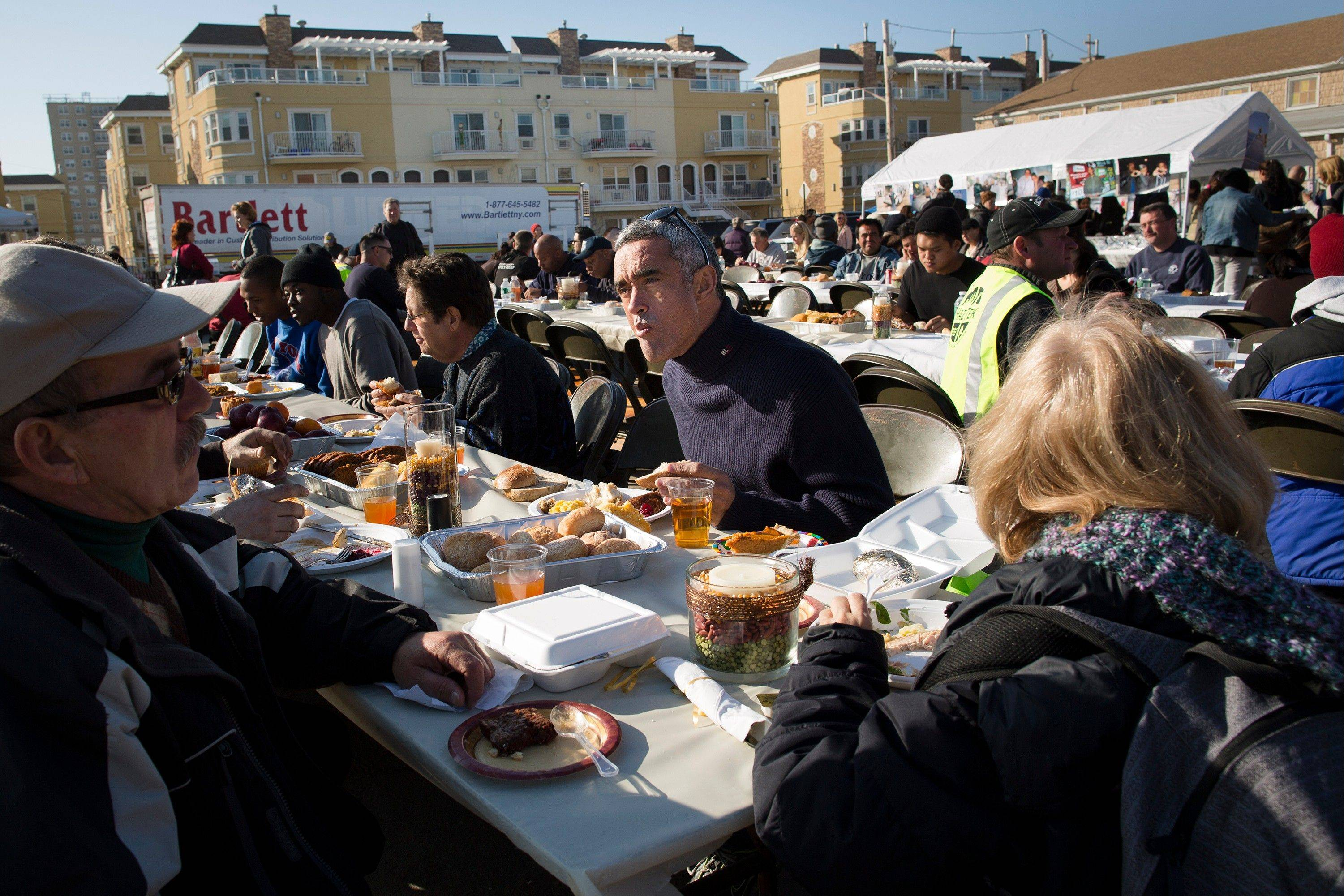 Denis Magoolaghan, 67, enjoys a free Thanksgiving dinner in the Rockaways section of Queens Thursday in New York. Portions of the Northeast are still reeling from Sandy�s havoc, and volunteers served thousands of turkey dinners to people it left homeless or struggling.