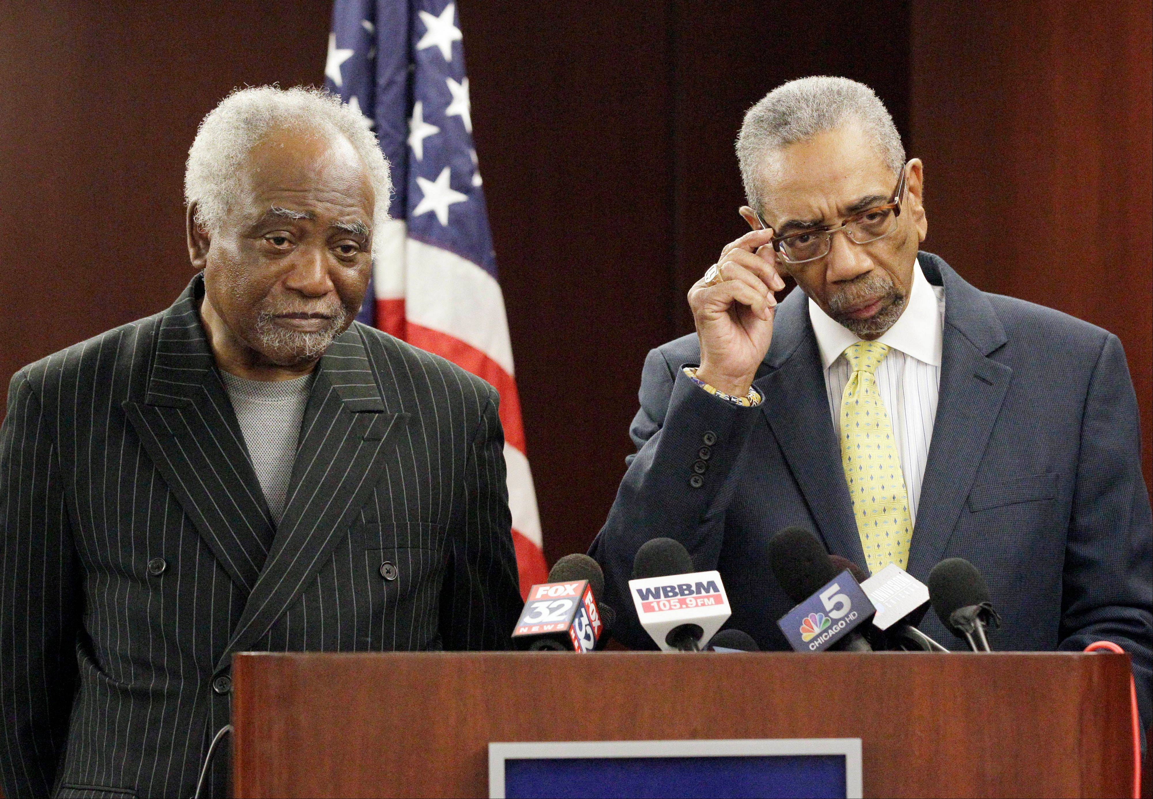 Rep. Bobby Rush, right, and Rep. Danny Davis listen to a question at a news conference in Chicago on Wednesday. Rep. Jesse Jackson Jr., son of a civil rights icon whose rising star aspirations and work as an effective local leader became engulfed by personal and ethical issues in recent years, quietly resigned from Congress Wednesday on an ominous tone.