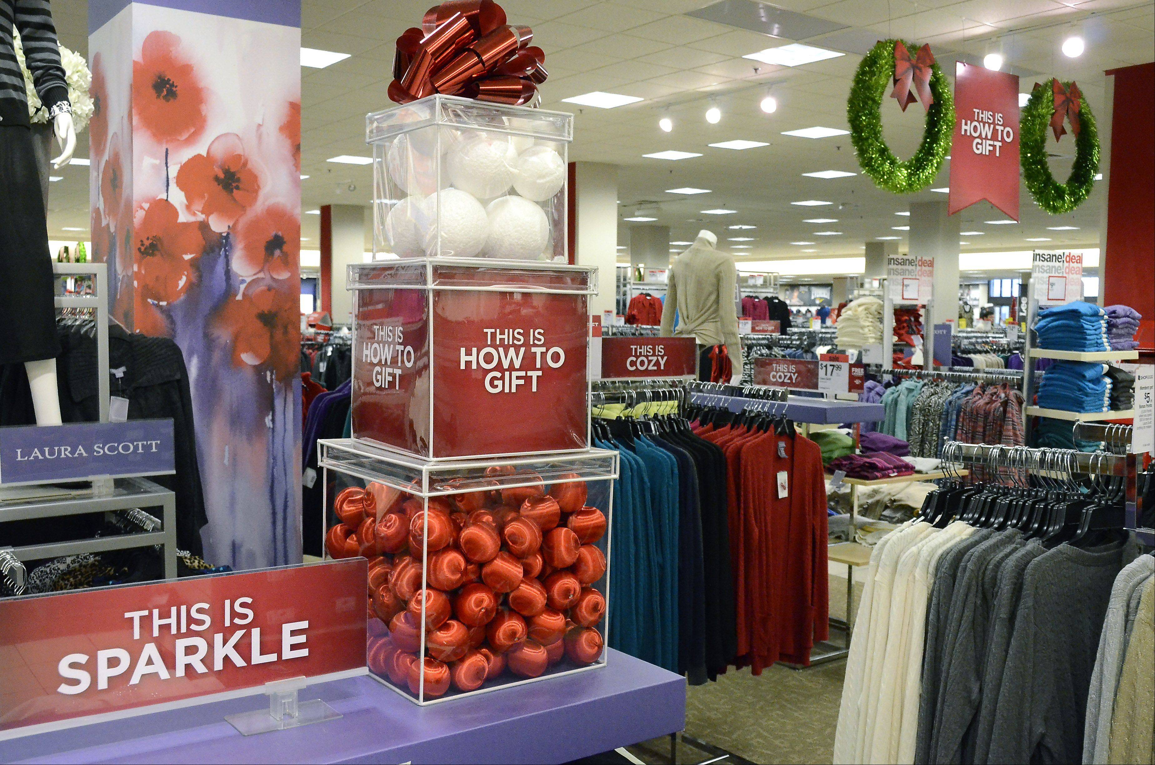 Signs at Sears in Woodfield Mall urge shoppers to start shopping for Black Friday deals before their turkey dinner is digested. Sears is one of several national retailers starting Black Friday sale at 8 p.m. on Thanksgiving this year.