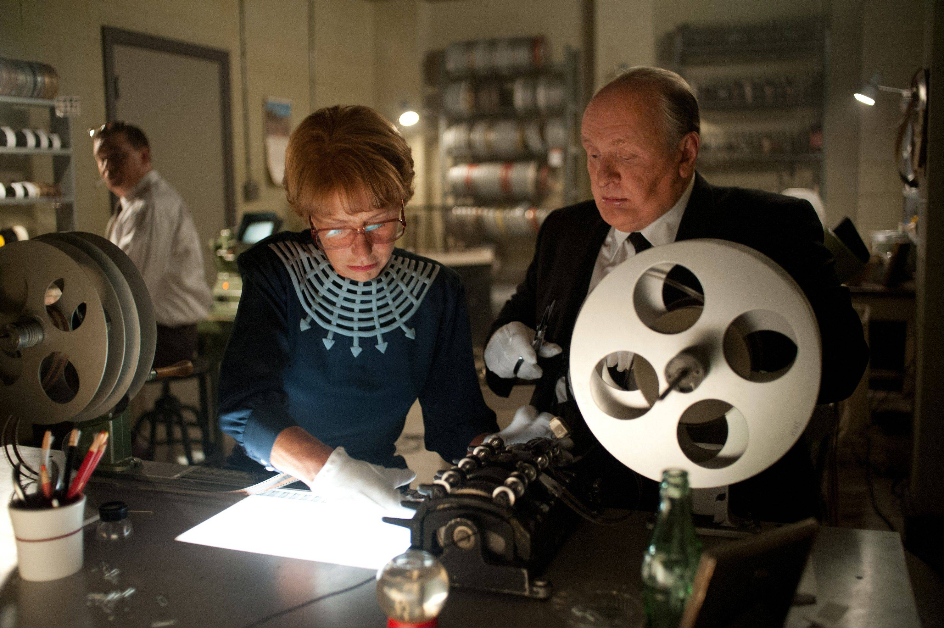 "Alma Reville (Helen Mirren), left, and her husband Alfred Hitchcock (Anthony Hopkins) go over a script in the amusing but flawed biographical drama ""Hitchcock."""