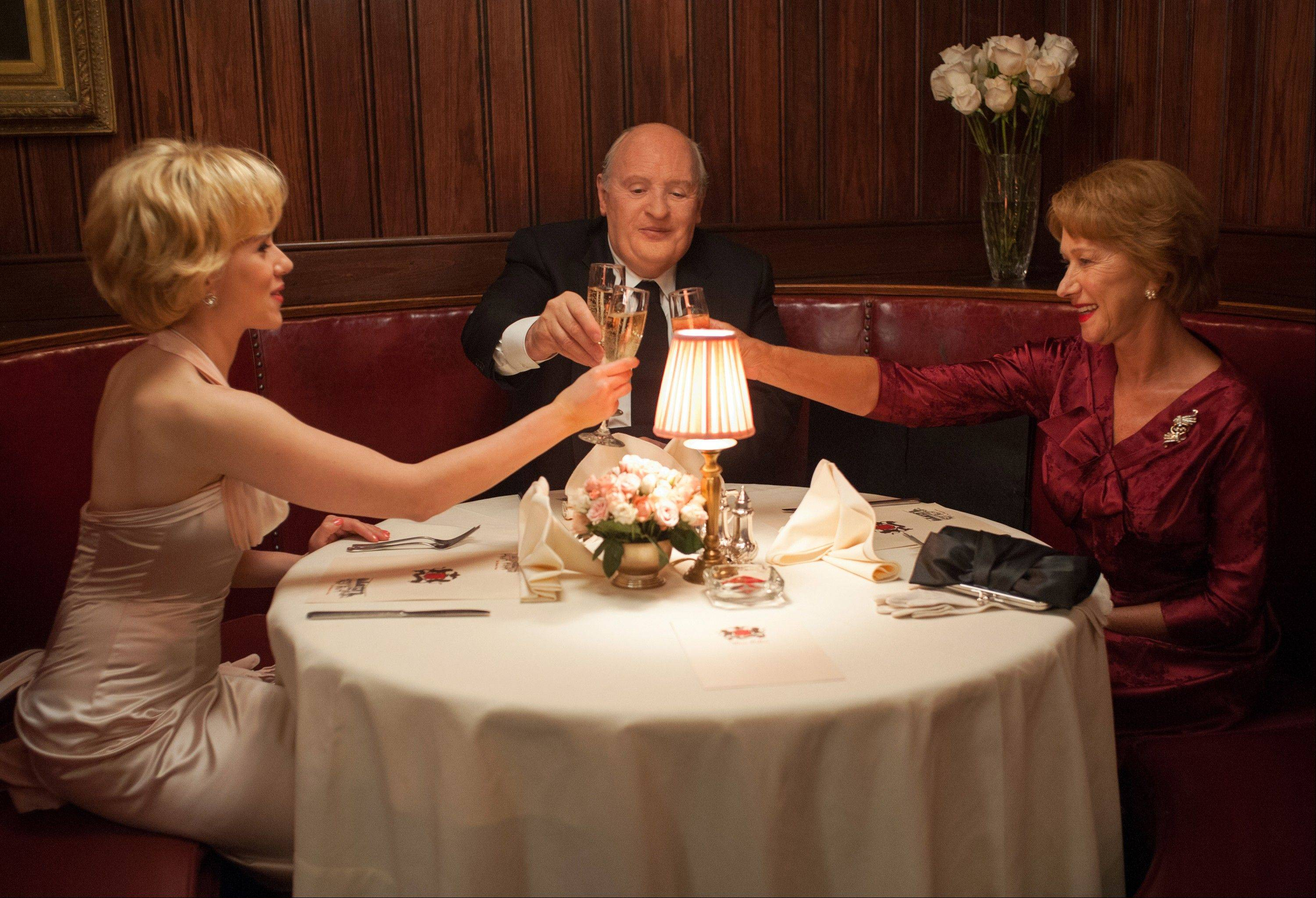 "Janet Leigh (Scarlett Johansson), left, joins Alma Reville (Helen Mirren) and her husband Alfred Hitchcock (Anthony Hopkins) for dinner in the amusing but flawed biographical drama ""Hitchcock."""