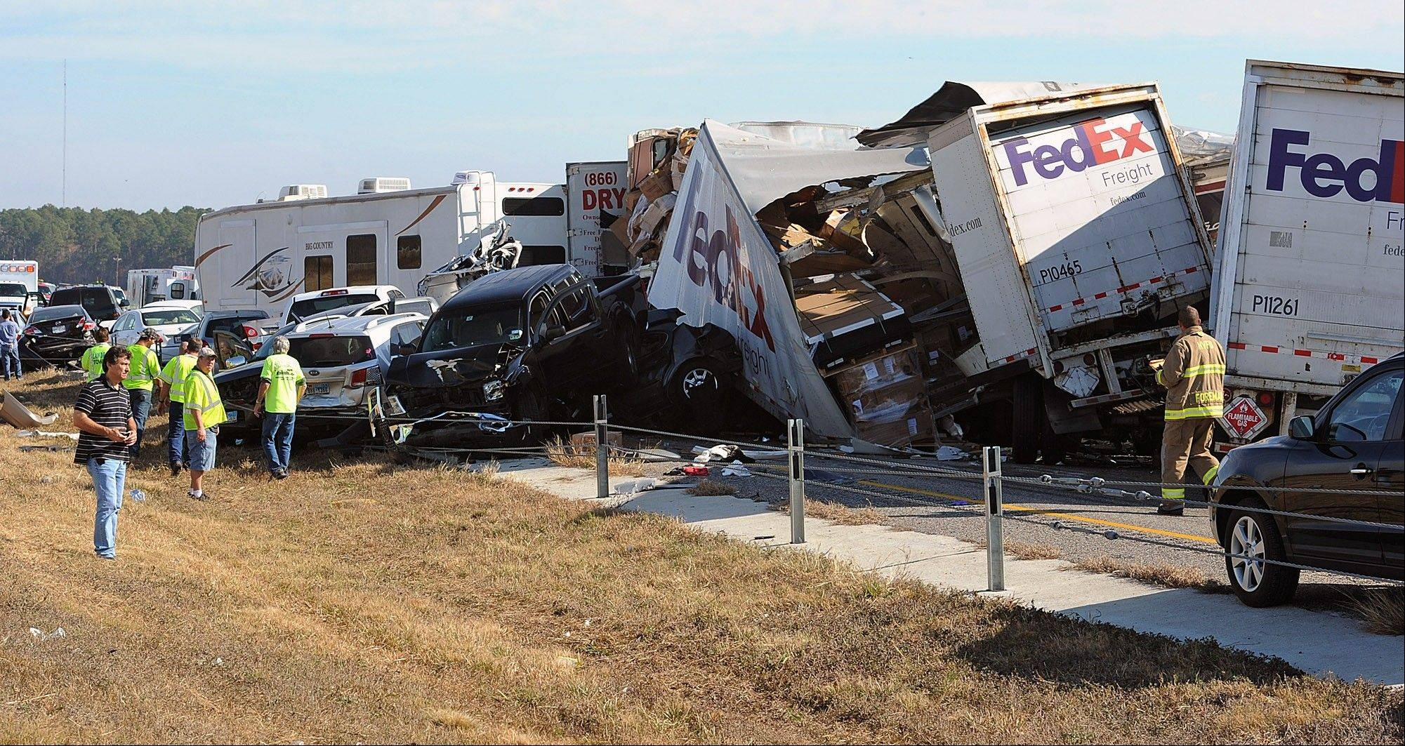 Cars and Trucks are piled on Interstate 10 in Southeast Texas Thursday. Two people died and dozens were hurt Thursday when at least 100 vehicles collided in Southeast Texas in a pileup that left trucks twisted on top of each other and authorities rushing to pull survivors from the miles of wreckage.