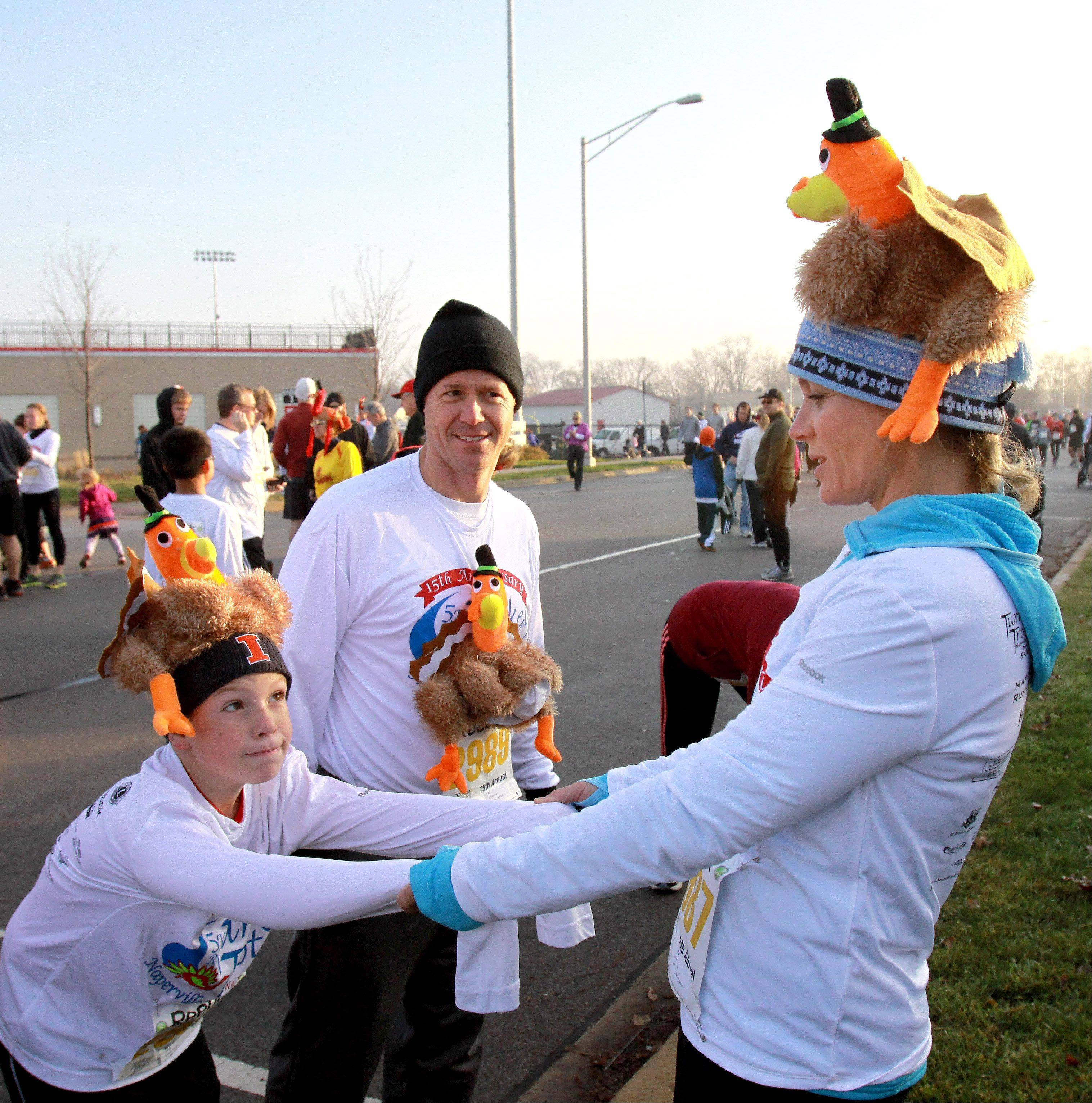 Lisa and John Endrud of Naperville and their son William, 9, prepare for the 15th annual Turkey Trot in Naperville.
