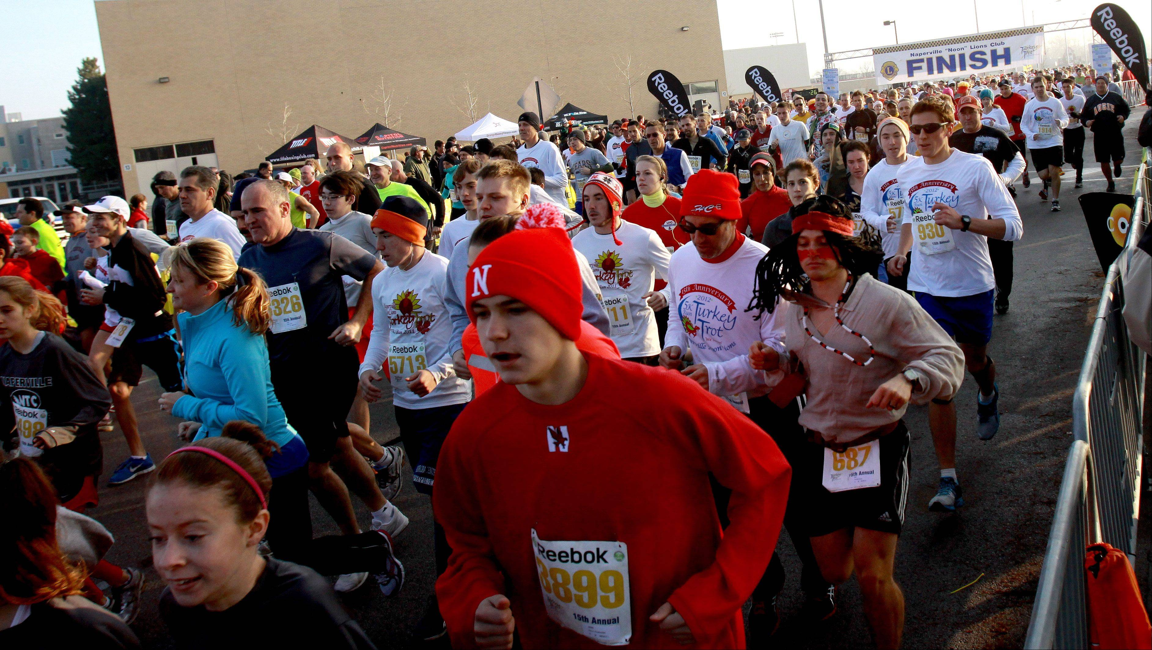 The Turkey Trot in Naperville draws thousands of runners, some dressing up, for the annual Thanksgiving 5K run.