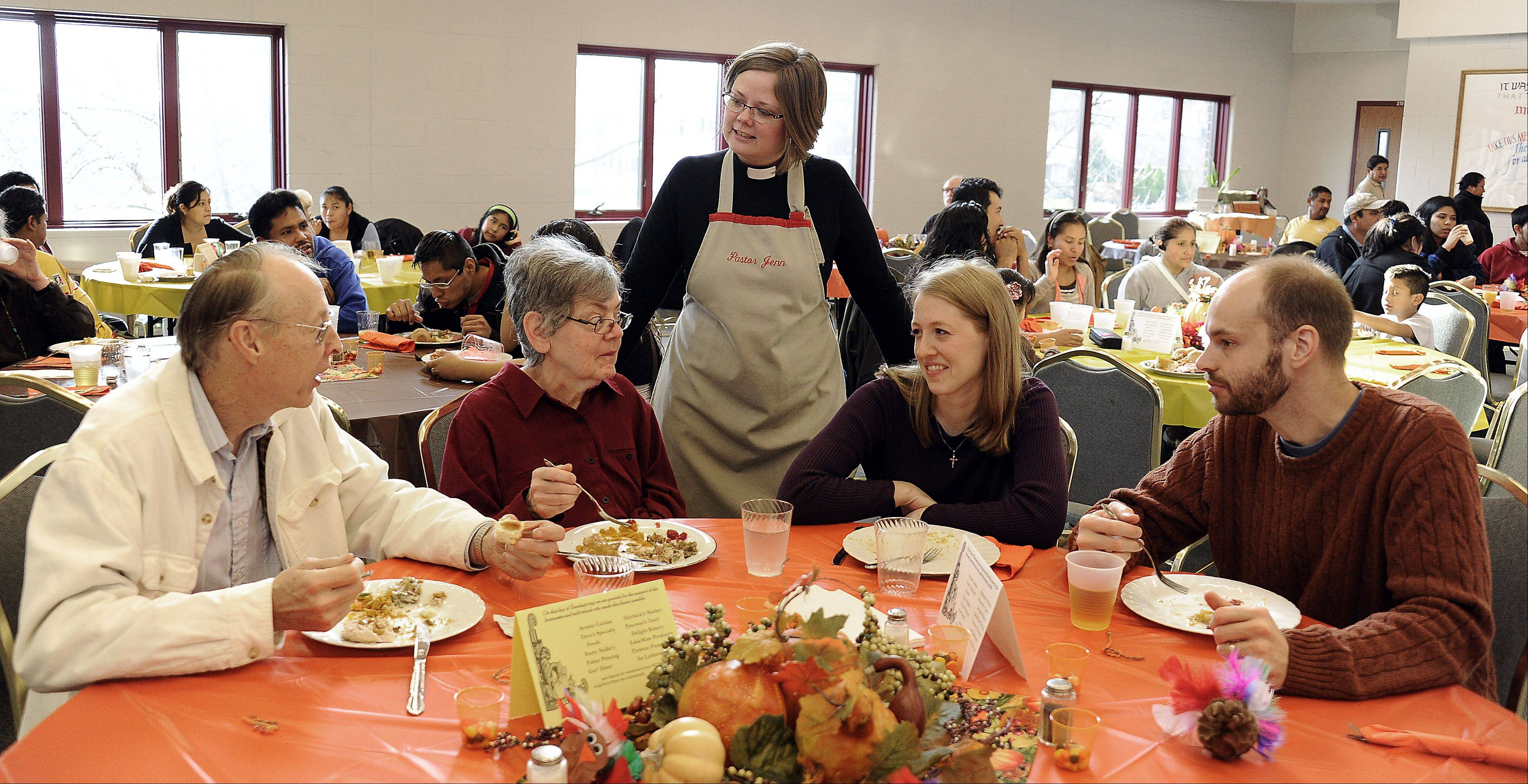 Pastor Jennifer Moland-Kovash talks to the family members, left to right, Milton and Paulette Boeger and Mary and John Lofgren of Palatine at the All Saints Lutheran Church Thankgiving dinner.