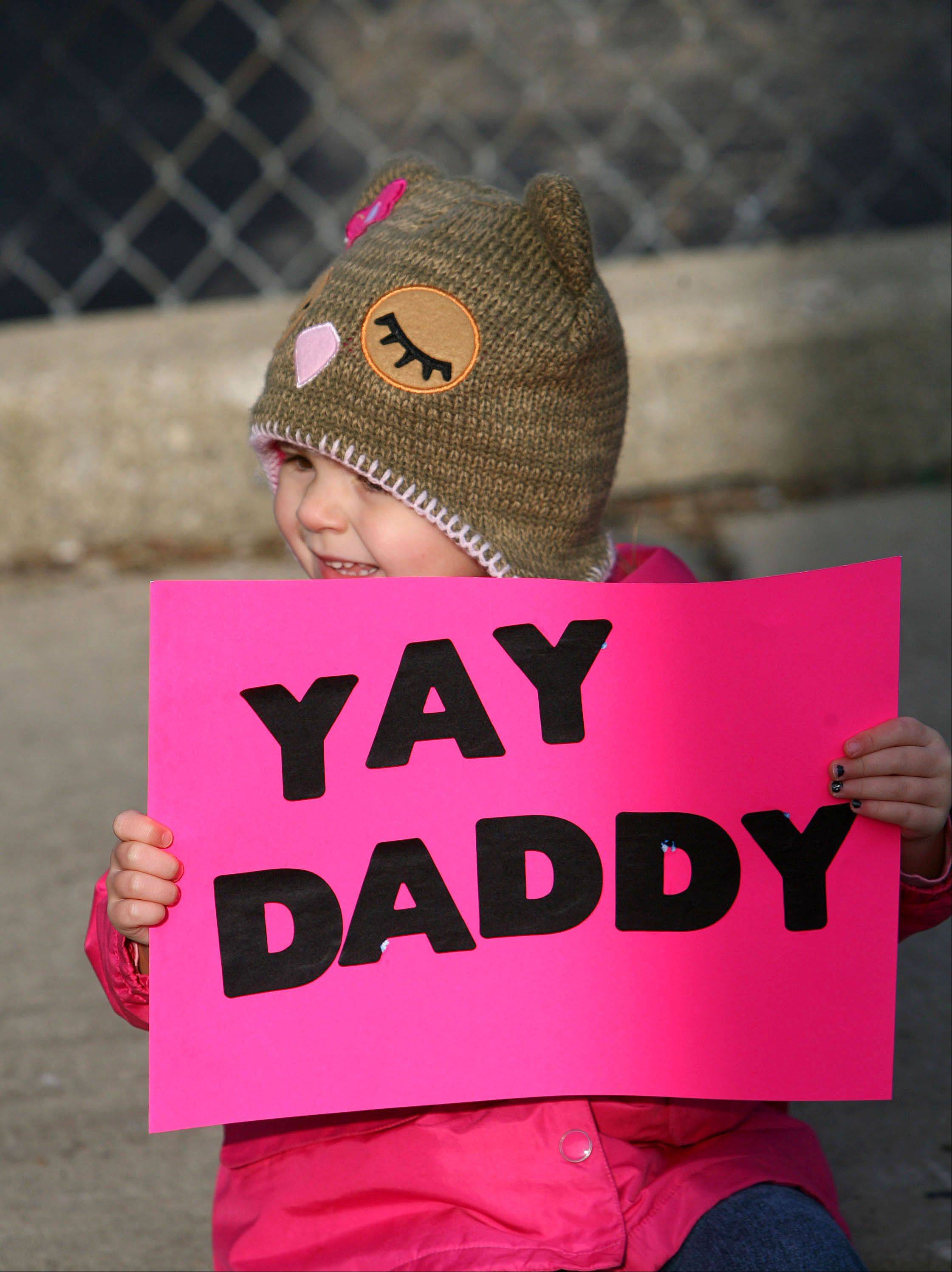 Three-year-old Ryan Little of Wauconda cheers on her daddy during the second annual Wauconda Turkey Trot.