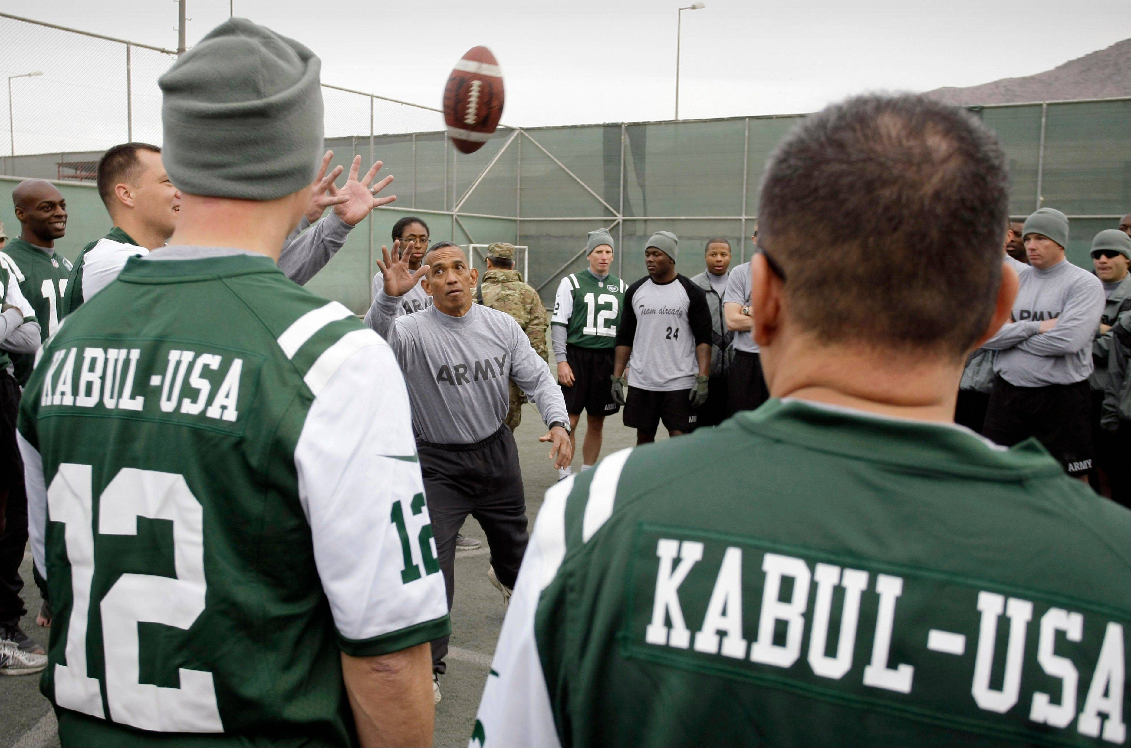U.S. Army Master Sgt. Wade Manol explains the rules of football to players during a six-team competition to mark Thanksgiving at the U.S.-led coalition base in Kabul, Afghanistan, Thursday, Nov. 22, 2012.
