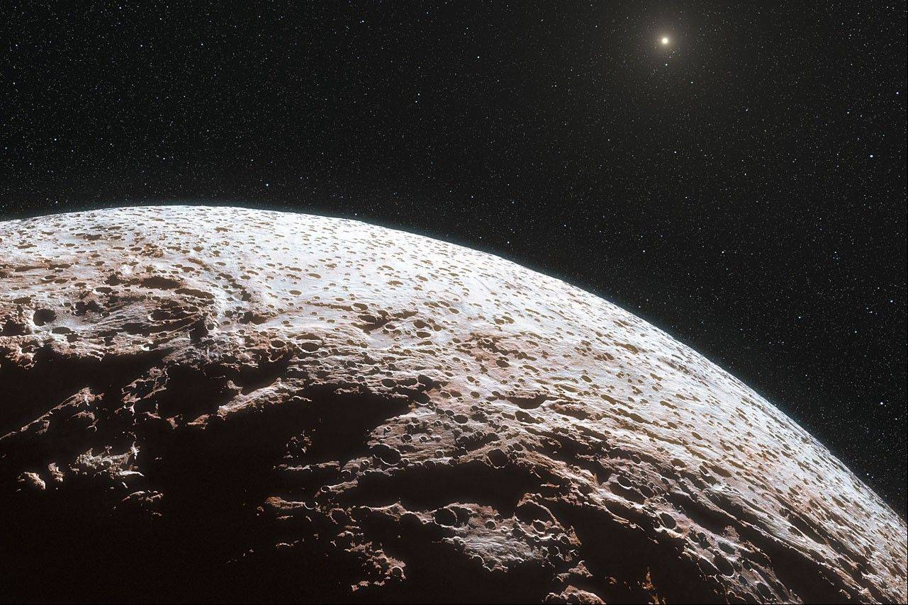 This artist impression provided by the European Southern Observatory and the journal Nature, shows the surface of the distant dwarf planet Makemake. This dwarf planet is about two thirds of the size of Pluto, and travels around the Sun in a distant path that lies beyond that of Pluto.