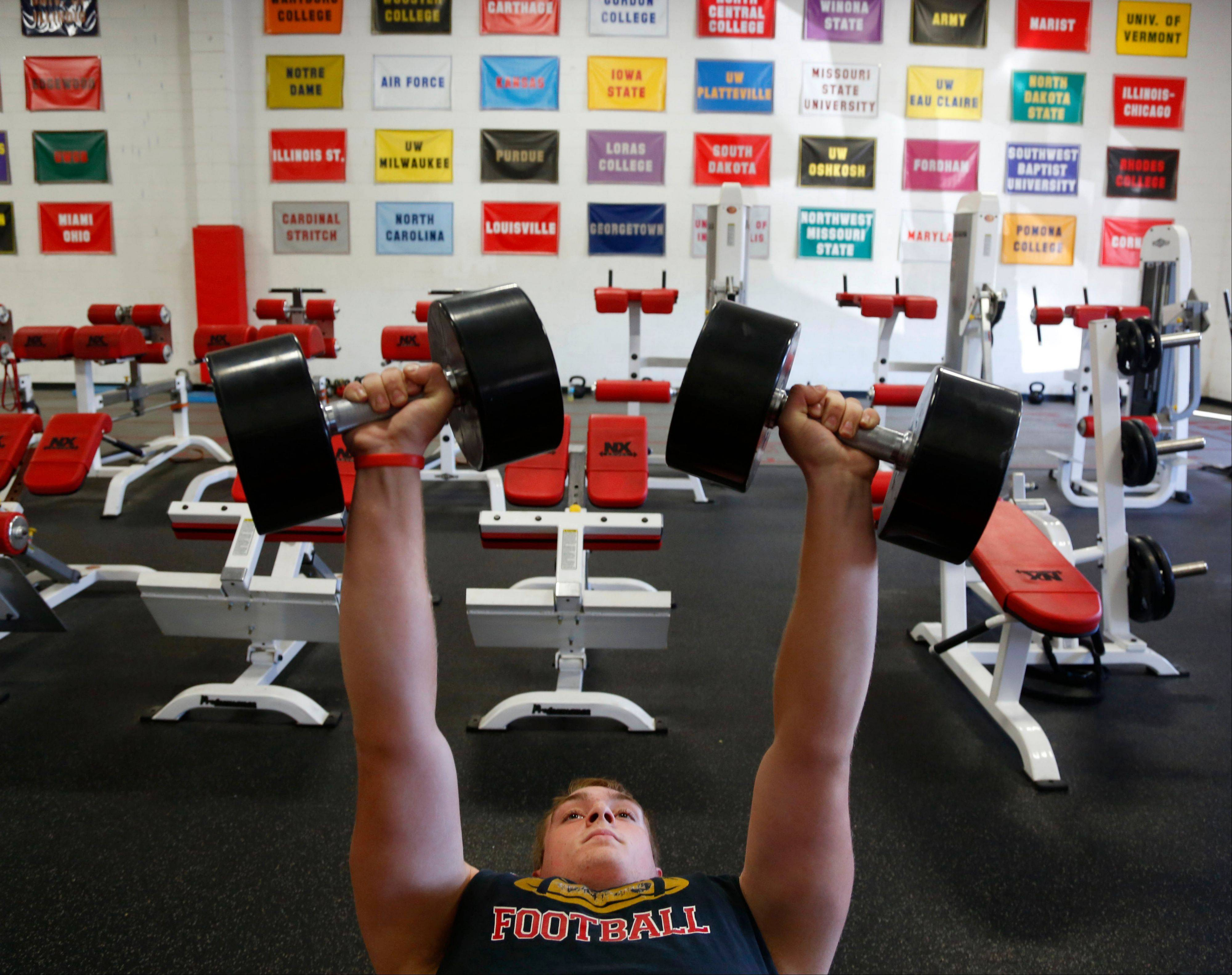 Billy Hirschfield, 16, lifts weights during a workout at NX Level, an elite training facility in Waukesha, Wis. The 6-foot-6, 270-pound high school junior and varsity football player is being recruited by major college football teams.