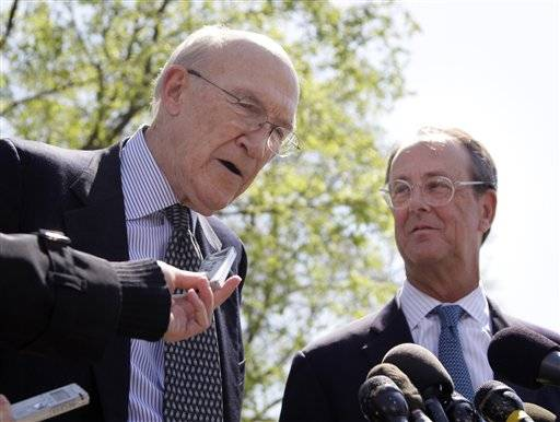 This April 14, 2011 file photo shows Erskine Bowles, right, Alan Simpson, co-chairmen of the president's deficit reduction commission, talking to reporters outside the White House in Washington after their meeting with President Barack Obama.