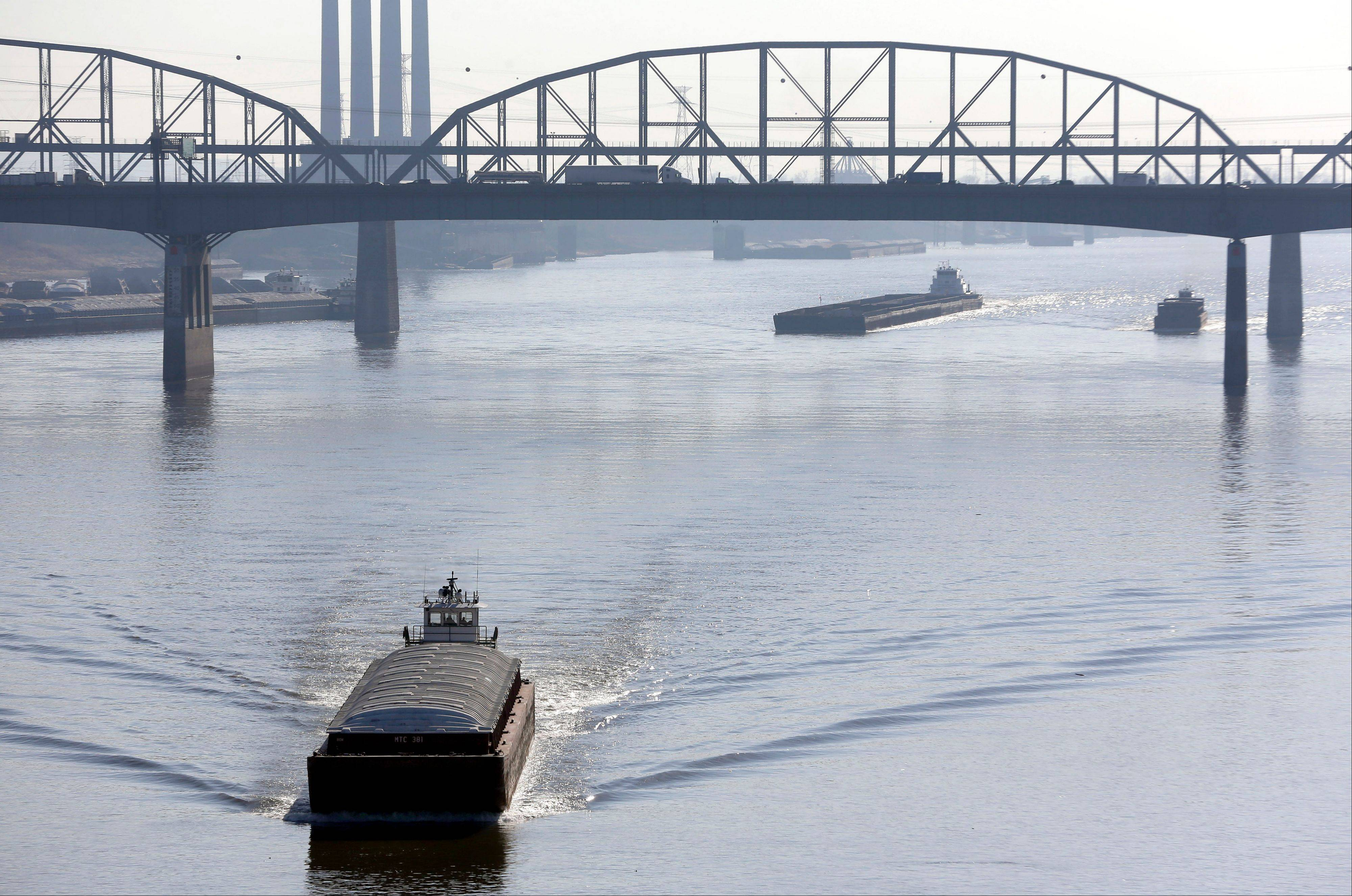 Barges power their way up the Mississippi River in St. Louis. The Army Corps of Engineers on Friday began reducing the flow from a Missouri River reservoir, a move expected to worsen low-water conditions on the Mississippi River and potentially bring barge traffic to a halt within weeks.