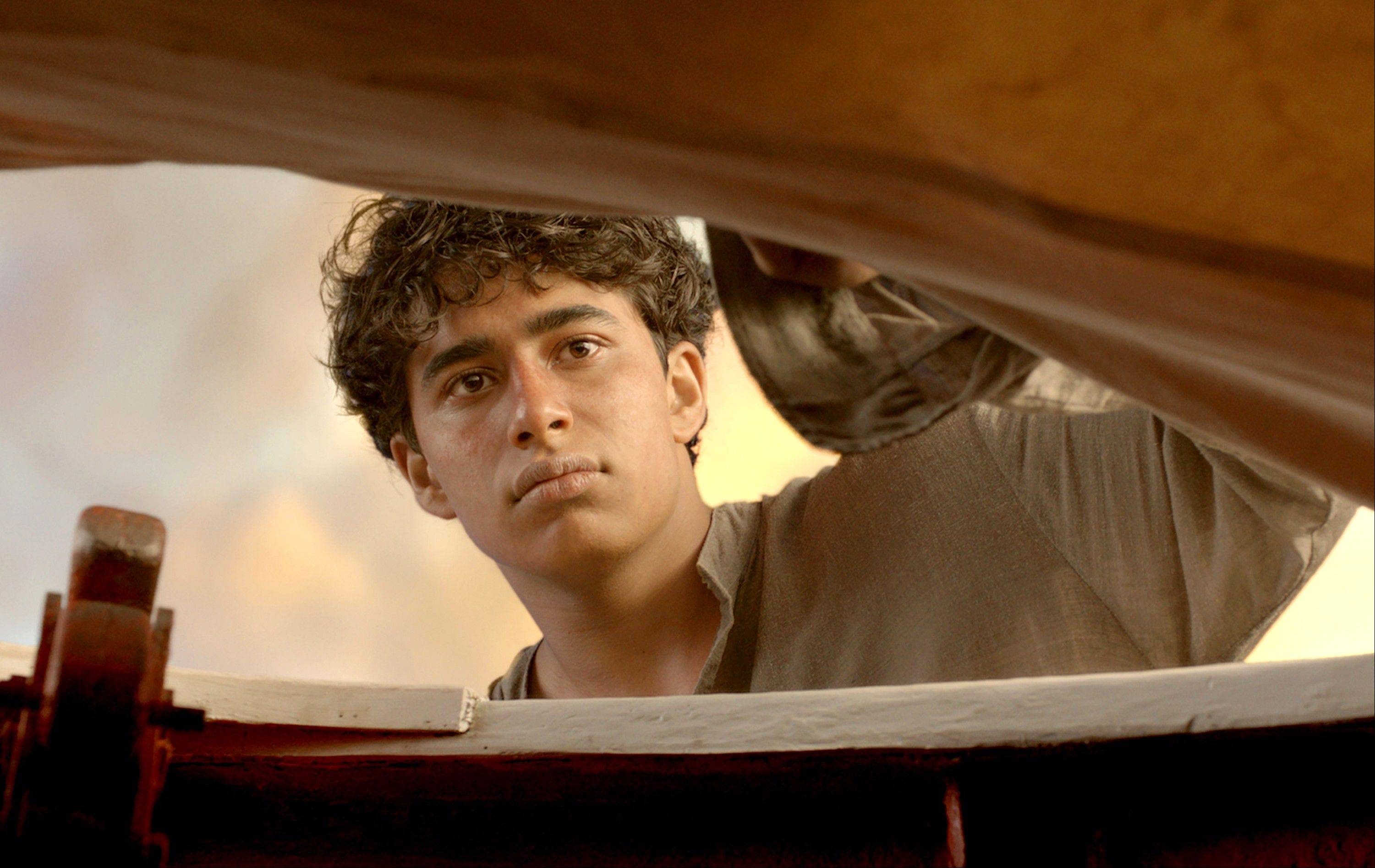 "Suraj Sharma goes on a wild adventure as Pi Patel in a scene from ""Life of Pi."""