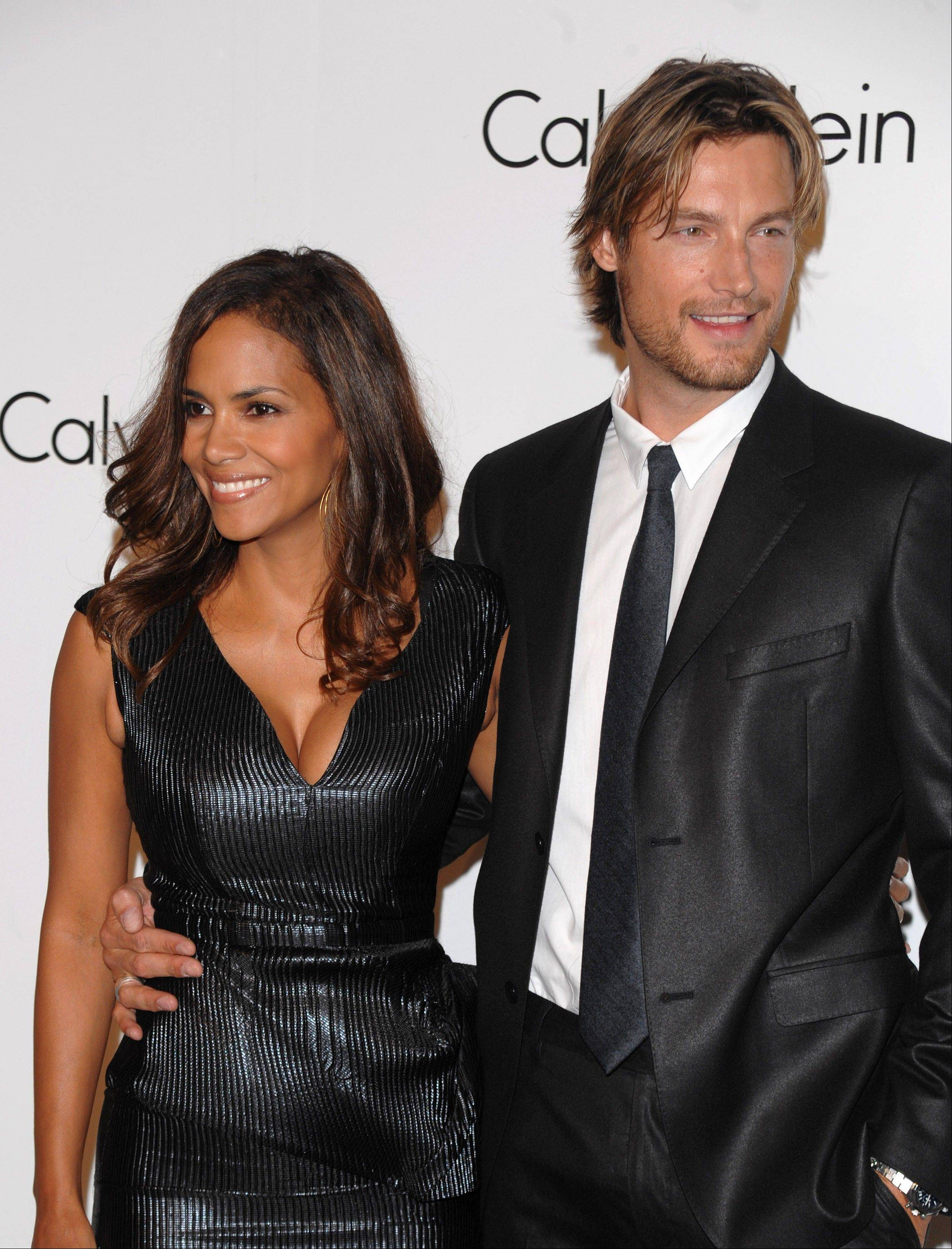 Halle Berry's ex-boyfriend Gabriel Aubry, right, was arrested for investigation of battery after he and the Oscar-winning actress' current boyfriend got into a fight at her California home, police said Thursday.