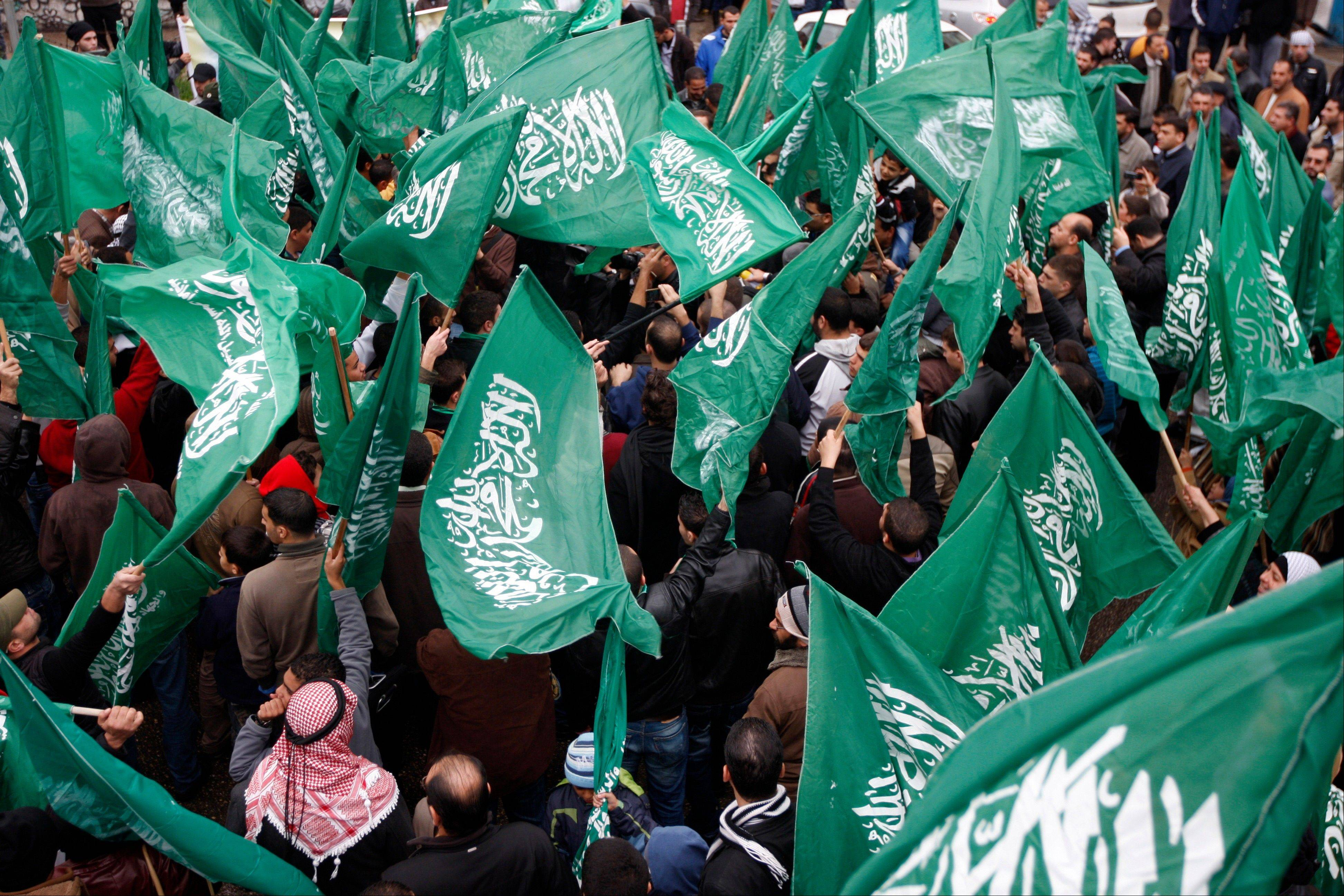 Hamas supporters wave the movement's flags during a pro-Hamas rally in the West Bank city of Ramallah, Friday, Nov 23, 2012.