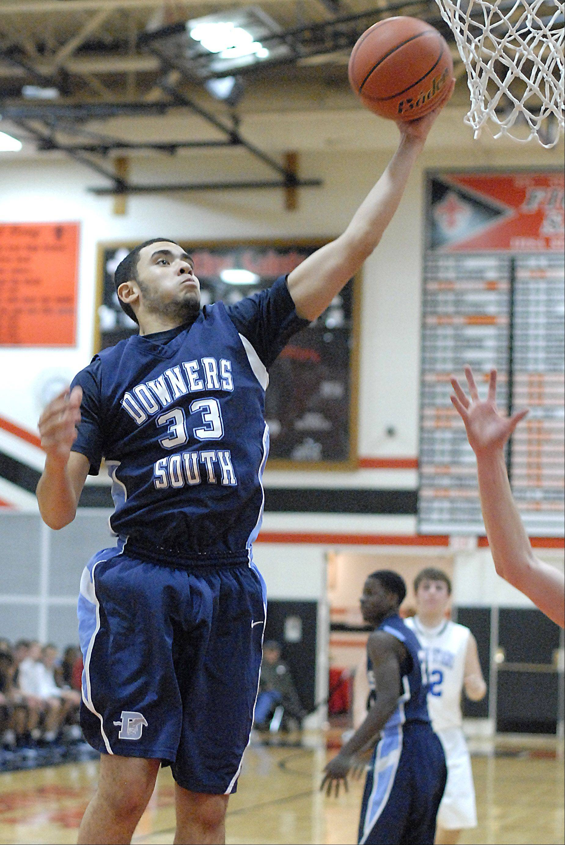 Downers Grove South�s Jordan Cannon grabs a rebound in the third quarter on Friday, November 23.