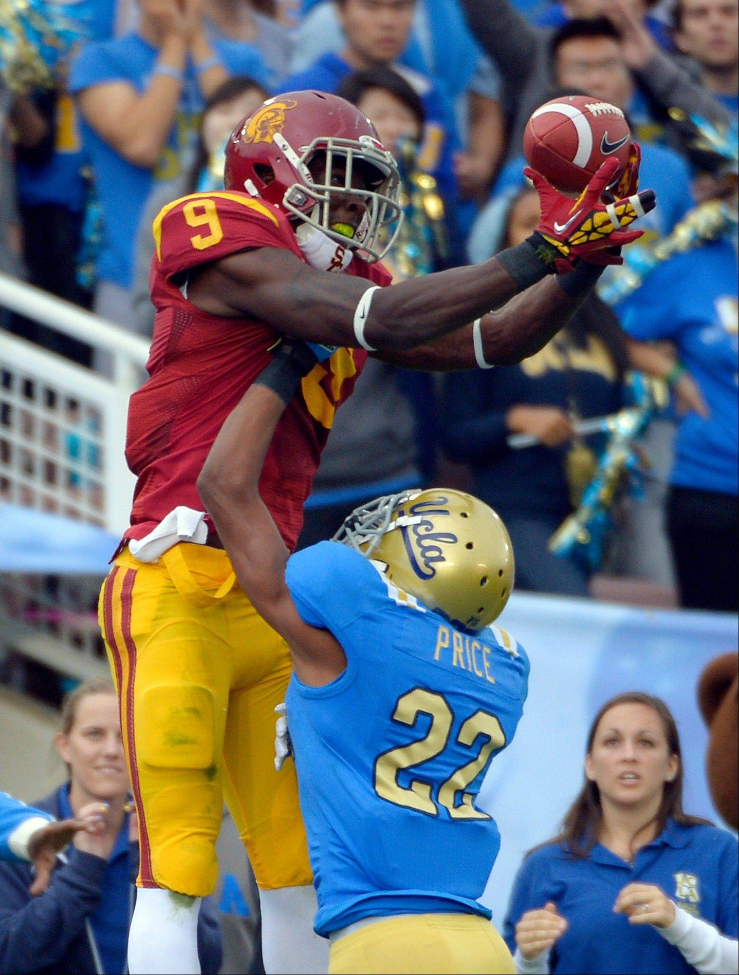 Southern California wide receiver Marqise Lee, left, will have to catch everything thrown his way from a freshman quarterback to give the Trojans a chance against No. 1 Notre Dame.