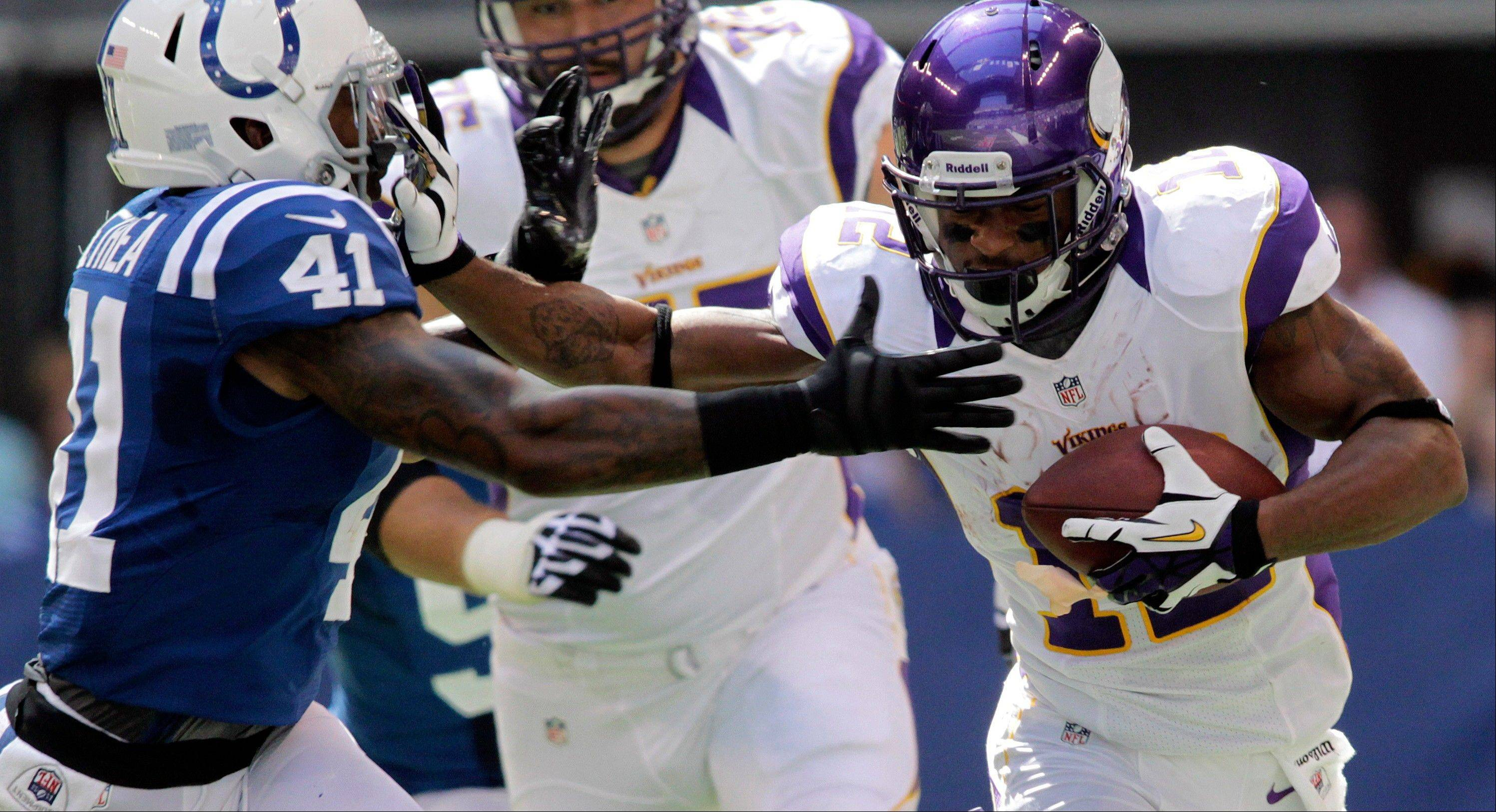Minnesota Vikings wide receiver Percy Harvin, right, runs against the Indianapolis Colts� Antoine Bethea earlier this season. The Vikings will likely be without Harvin again this weekend because of his sprained left ankle.
