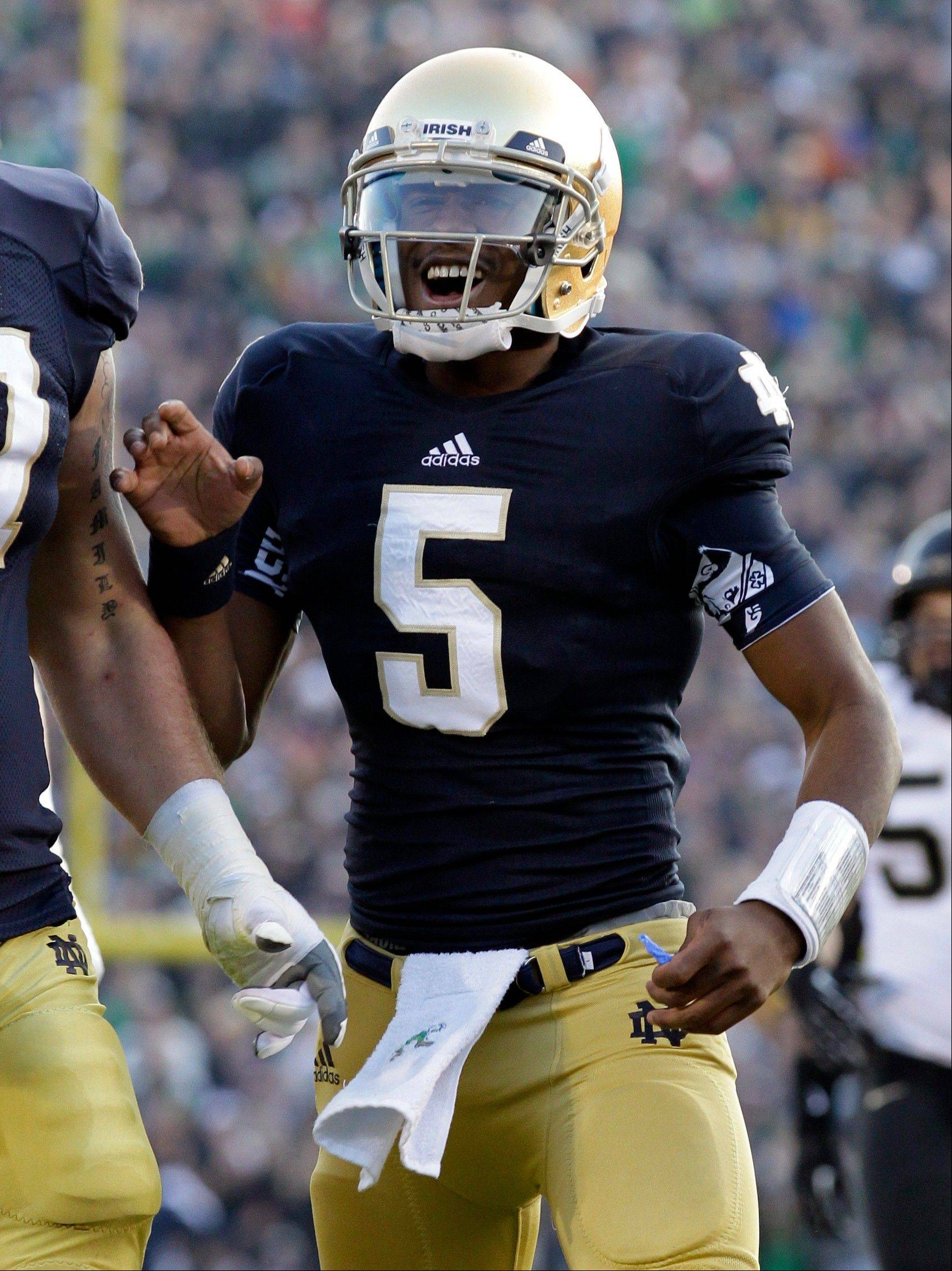Notre Dame quarterback Everett Golson and his Fighting Irish teammates are favored to beat Southern California on Saturday night and finsih their regular season unbeaten.