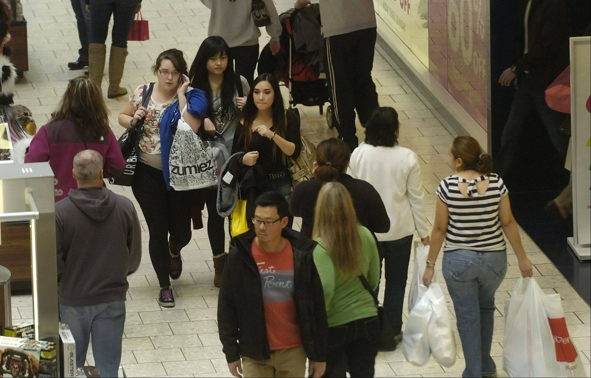 Shoppers look for bargains as they navigate Woodfield Mall in Schaumburg on Black Friday.