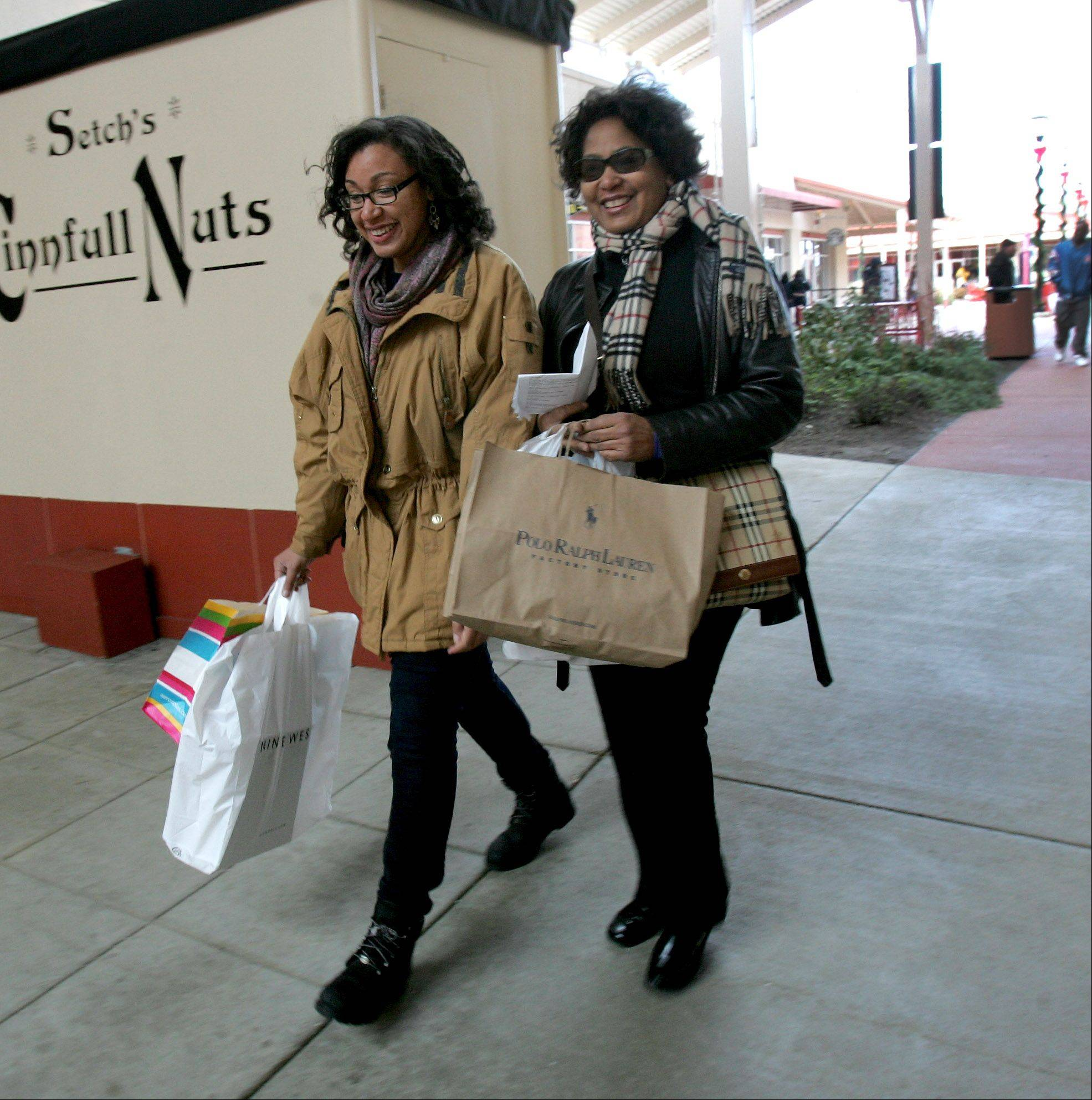 Liz Jordan, left, of Chicago, and mom Judy Jordan find some deals at Chicago Premium Outlets in Aurora on Friday.