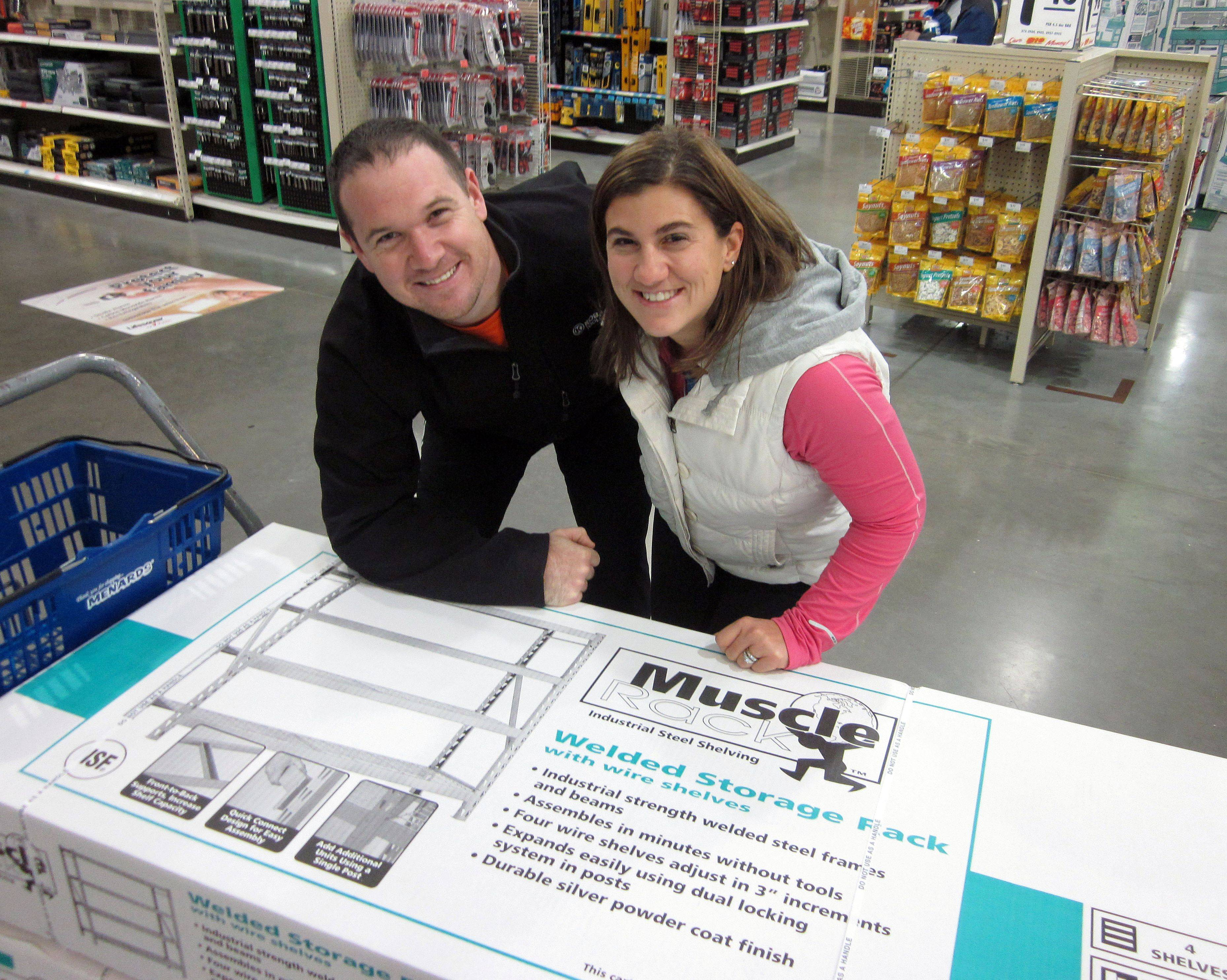 Shaun and Carolyn Herda of Milwaukee came to Menards in Long Grove at 6 a.m. Friday to save a bundle on shelving for a new garage.