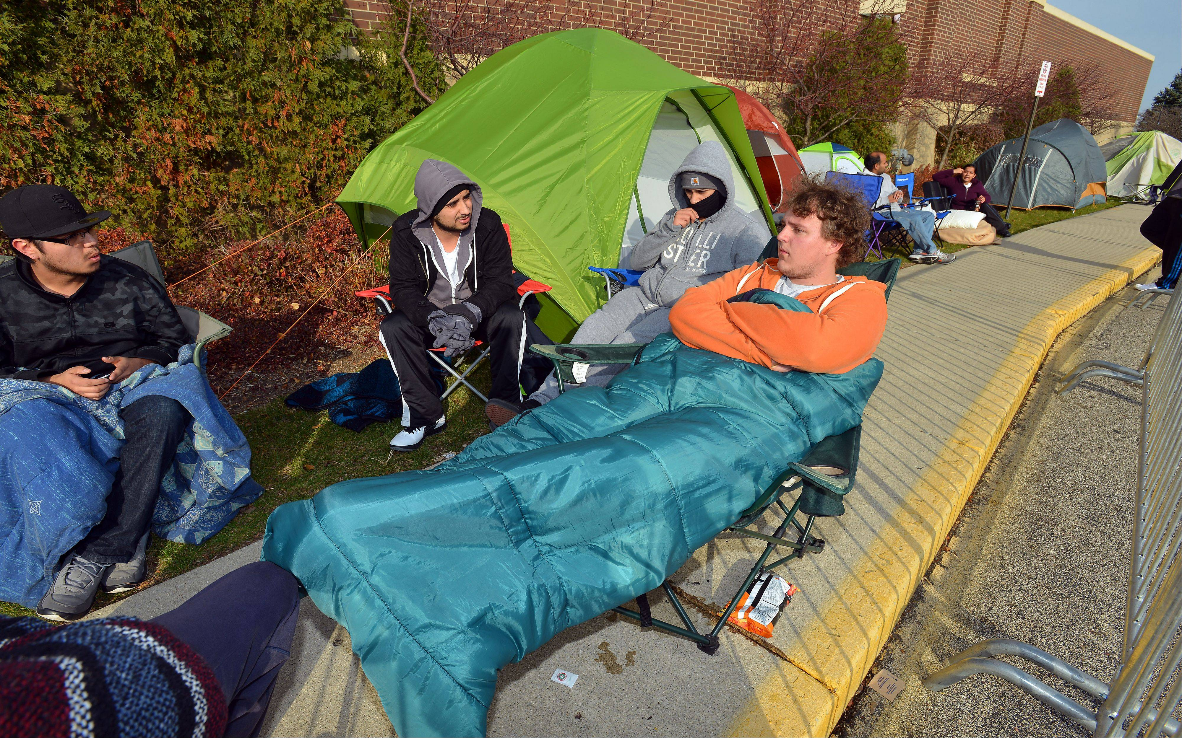 Tent city in front of the Best Buy in Schaumburg popped up at 12 a.m. on Tuesday. Matt Runowski, 20, of Streamwood keeps warm in his sleeping bag with the rest of his friends as they try to get their hands on Best Buy's Black Friday deal, a 40-inch flat screen TV for $179.99.
