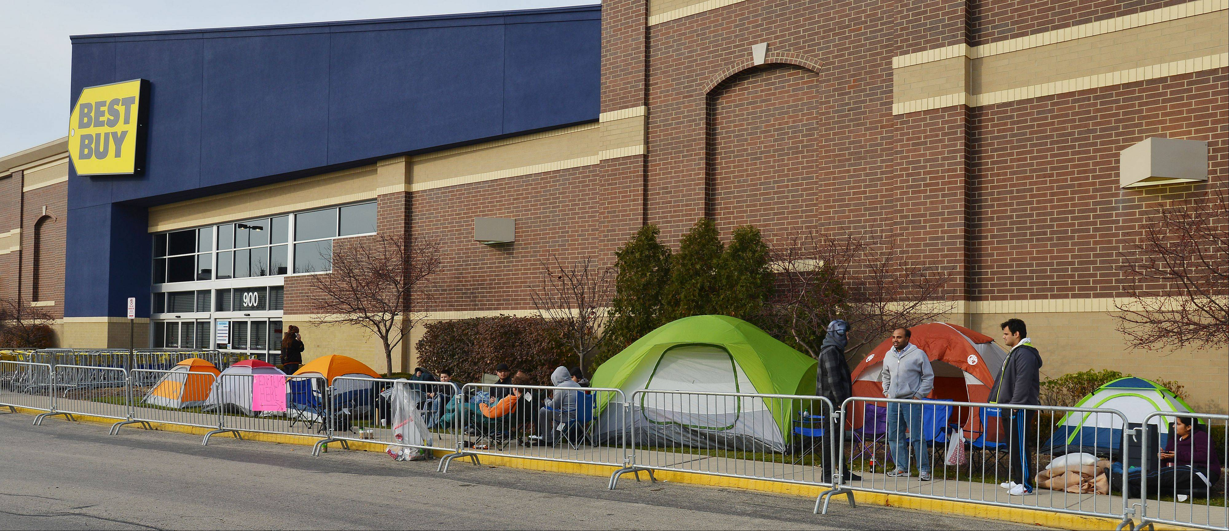 Tent city in front of the Best Buy in Schaumburg popped up at 12:00am on Tuesday with Felipe Acosta, 33, of Mt. Prospect driving the first tent stake looking for Black Friday deals skipping his Thanksgiving dinner.
