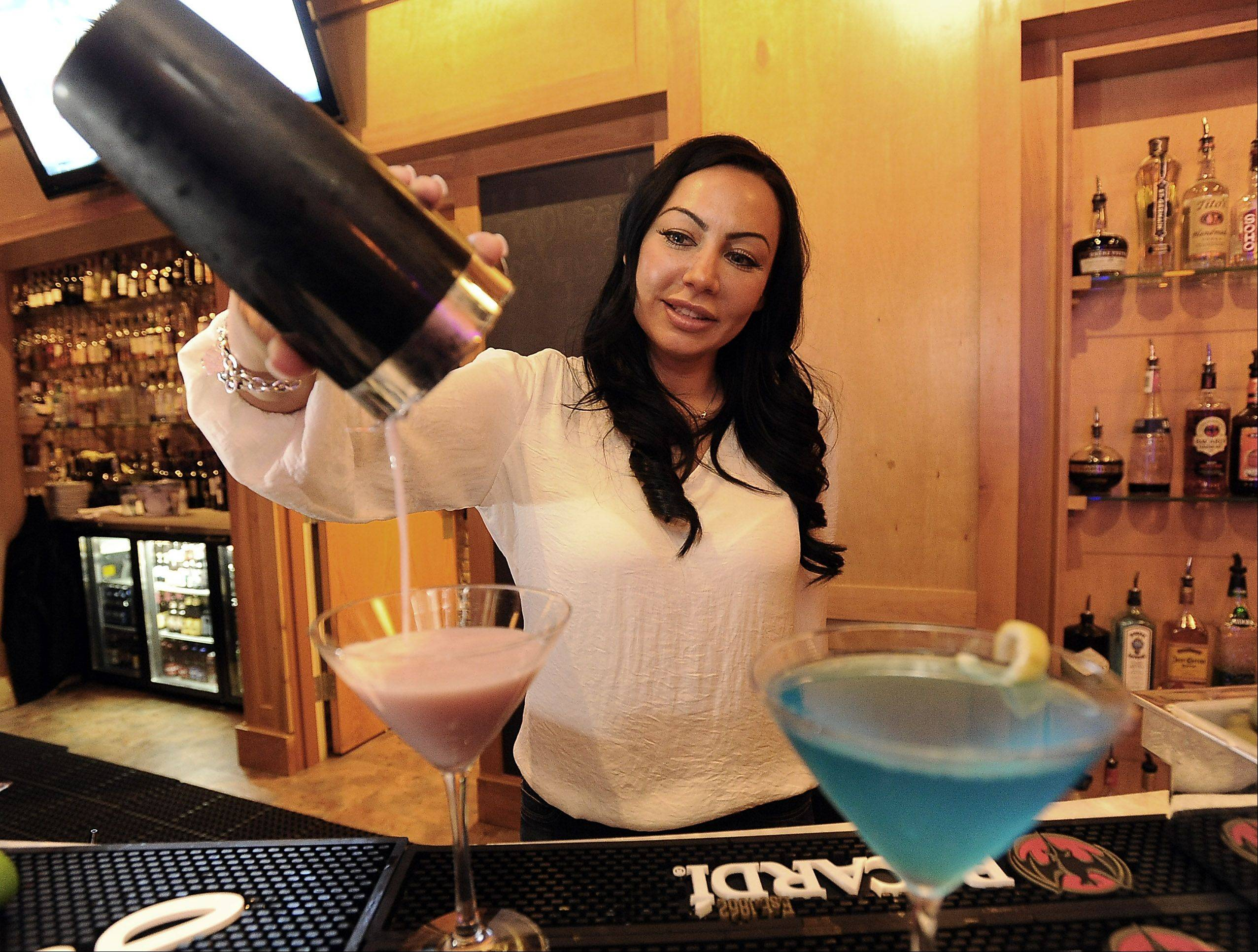 Bartender Diana Spence mixes up a martini at The Annex in Barrington.