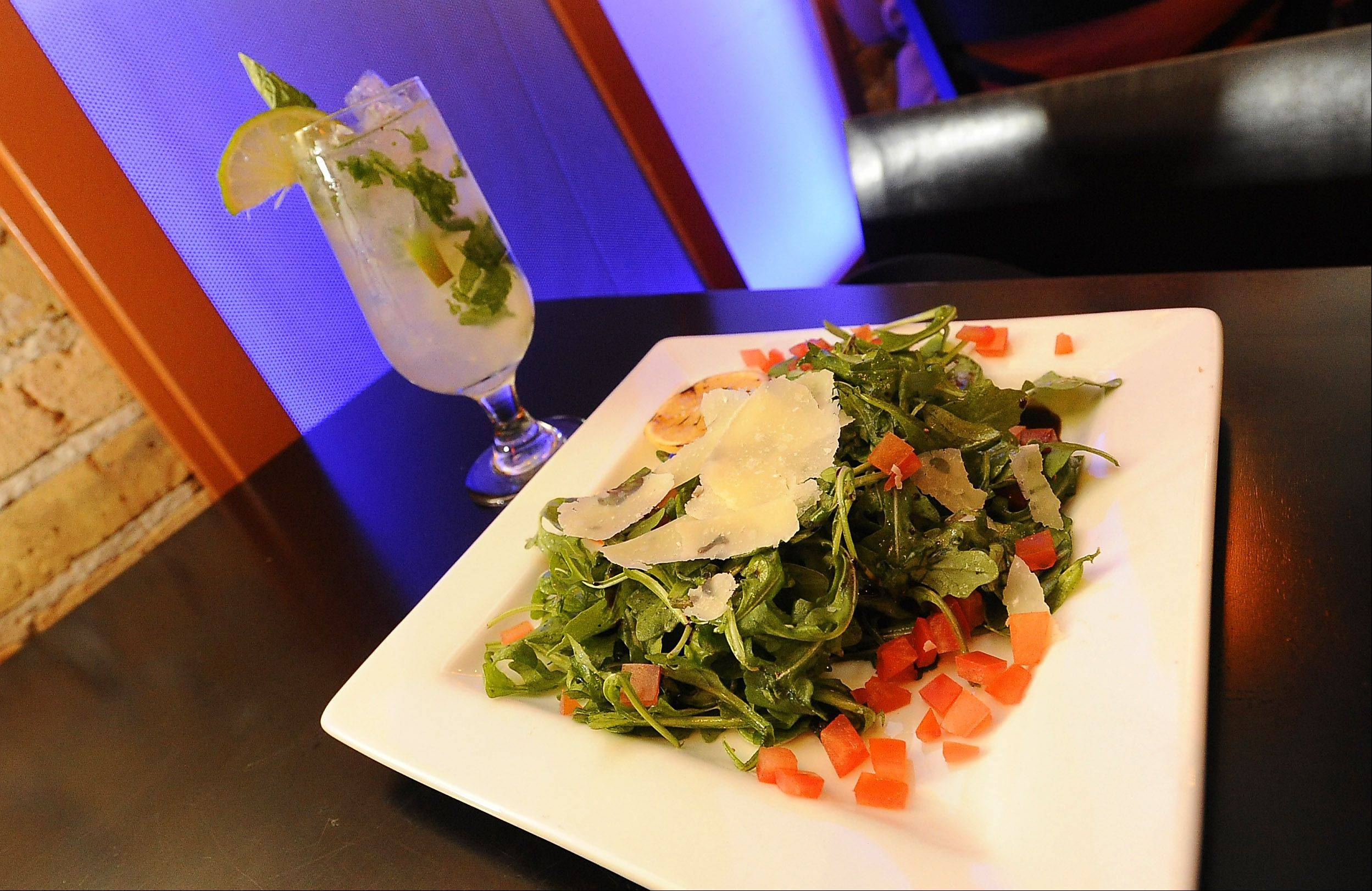 The Annex's arugula salad comes topped with shavings of parmesan cheese.