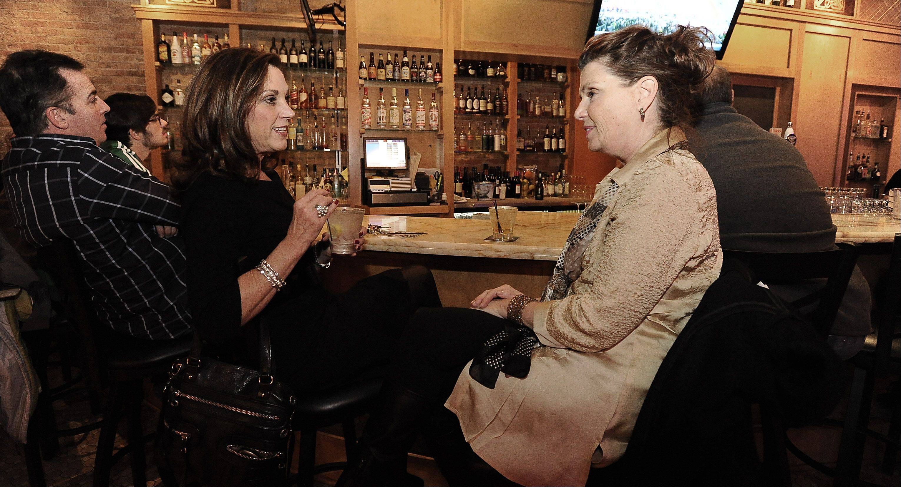 Sandy Canada of Barrington and Kathy Schroeder relax over drinks at The Annex in Barrington.